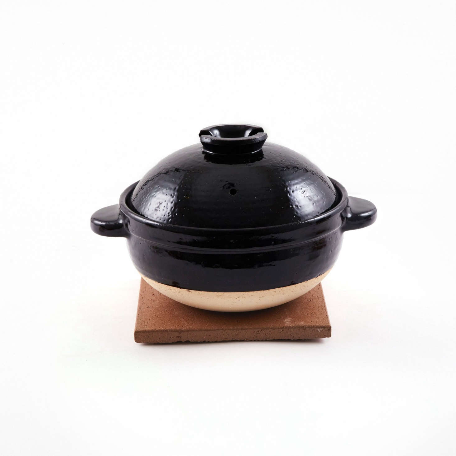 The Kamado-san double-lid donabe is the classic donabe for rice: It has a porous clay body designed to heat rice gently, and a double-lid system that functions like a pressure cooker. Prices start at $120 for a one-cup size; the three-cup pot, shown, is $180.