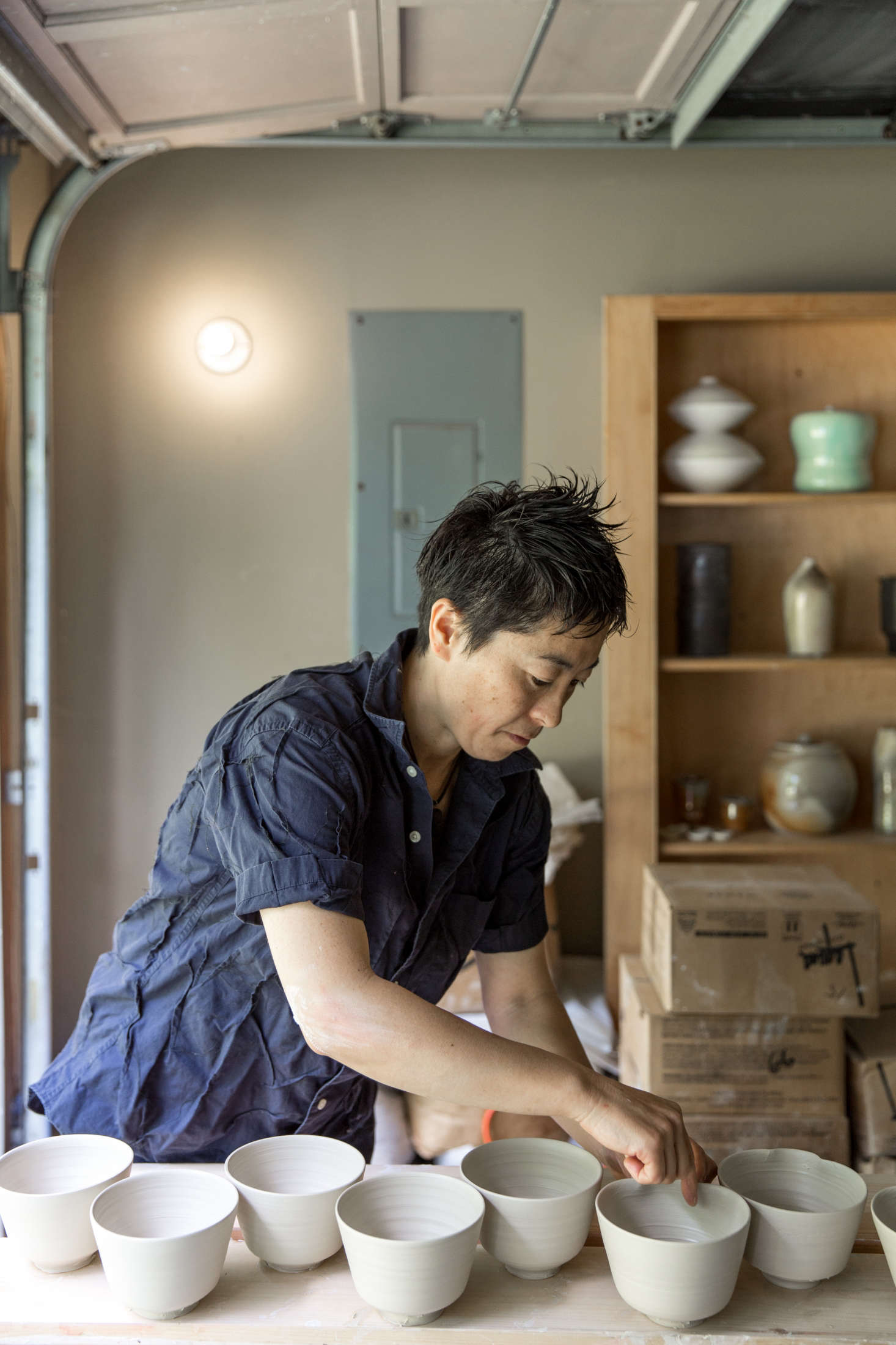 Nakazato at work in her Maine studio, a converted garage at the end of a dirt road.