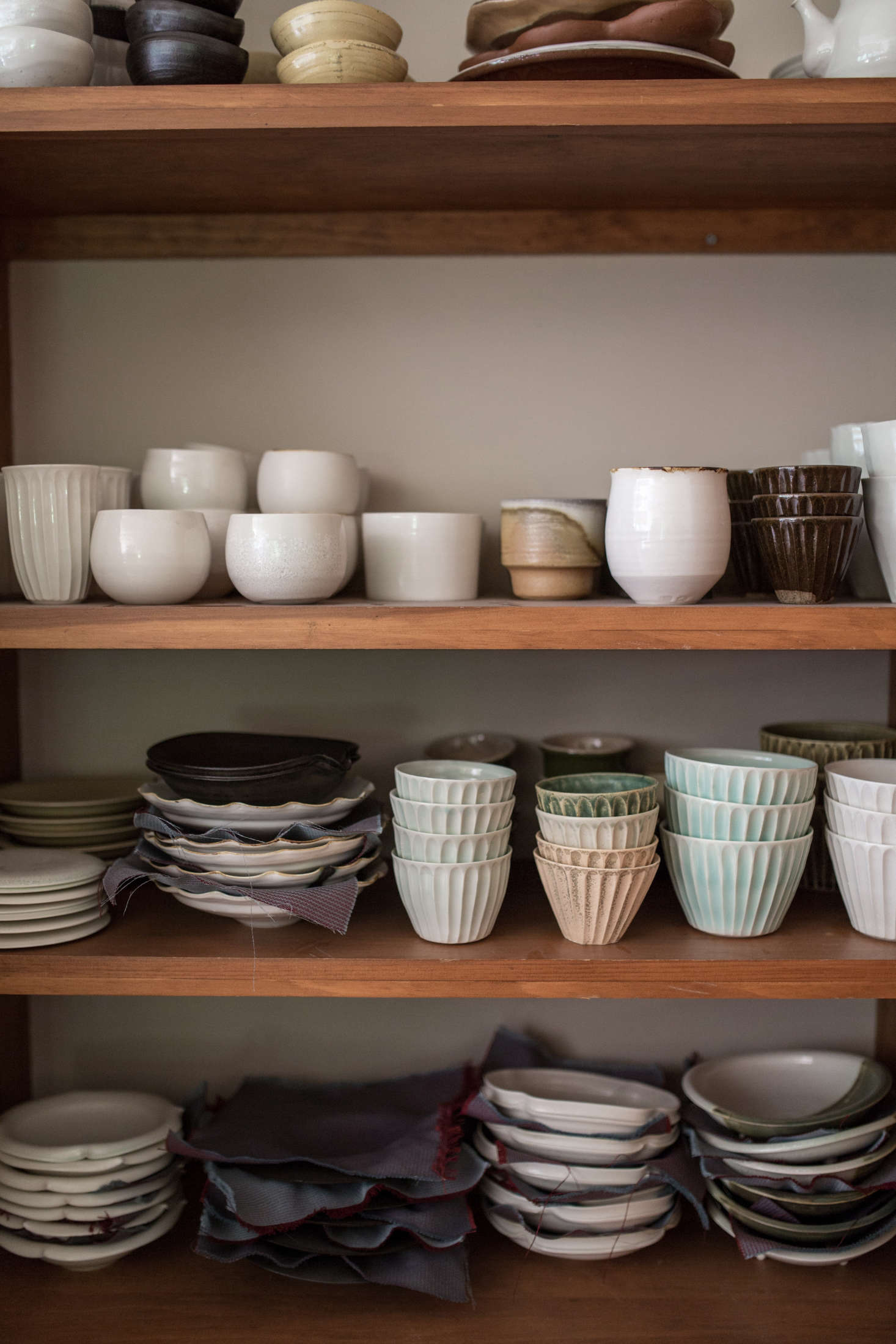 Stacks of Nakazatou0027s work are cushioned by small cloths to prevent chips and cracks. Nakazato & Downeast Meets Japan: A 14th-Generation Ceramicist at Home in Maine ...