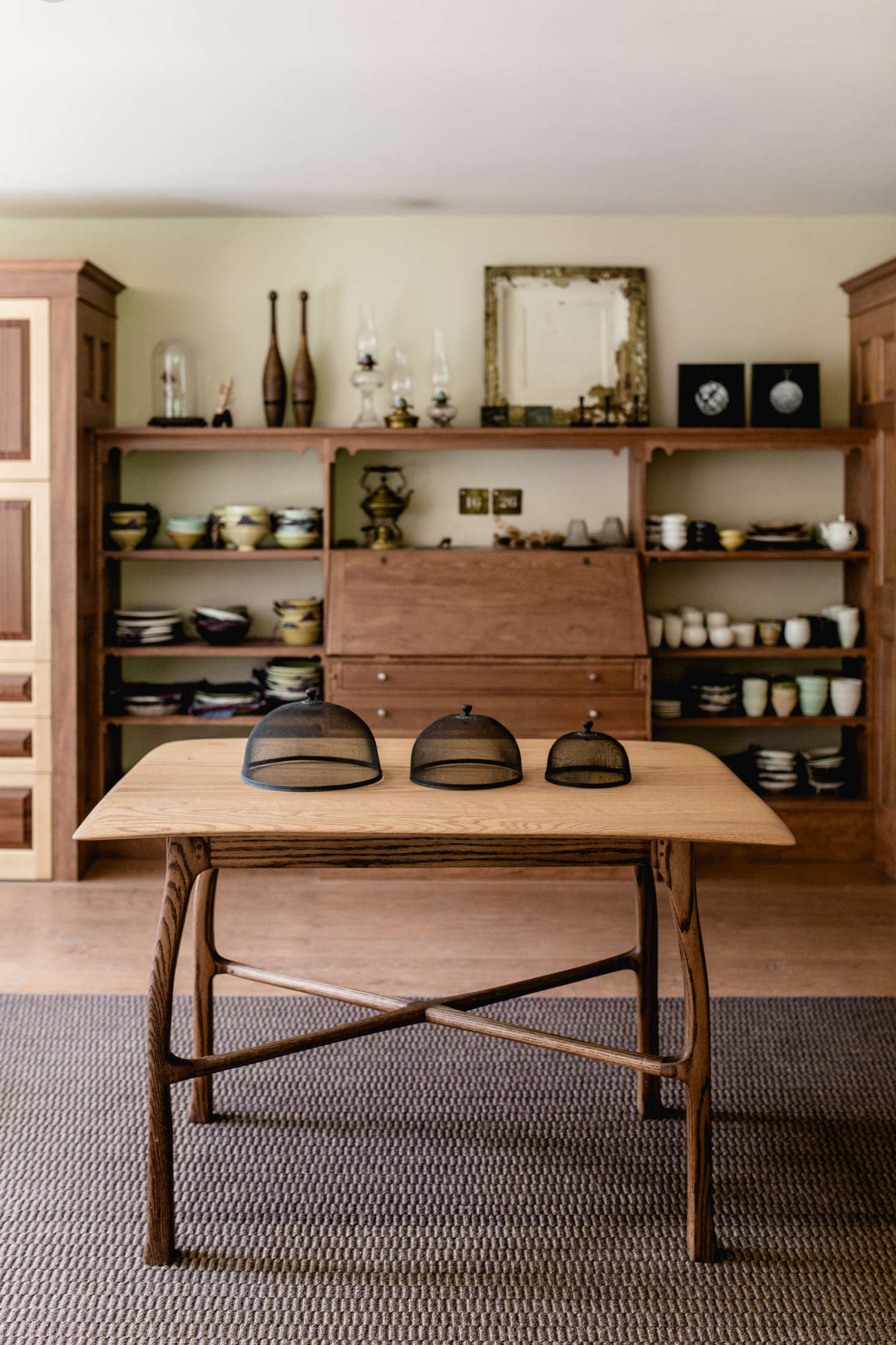 Nakazato and Stuart-Wolff converted the existing dining room—and its built-in shelves and drop-leaf writing desk—into a place to display Nakazato&#8