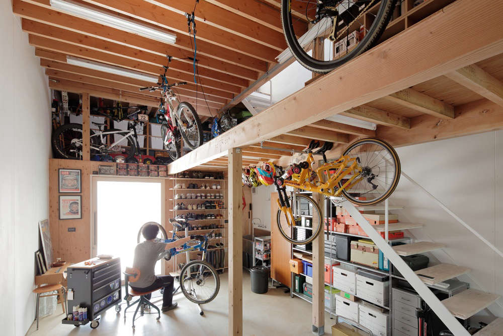 The product designer's workshop is right off the front door. Bikes are hoisted to the storage loft by Rad Bike Lifts; $22.37 via Amazon.