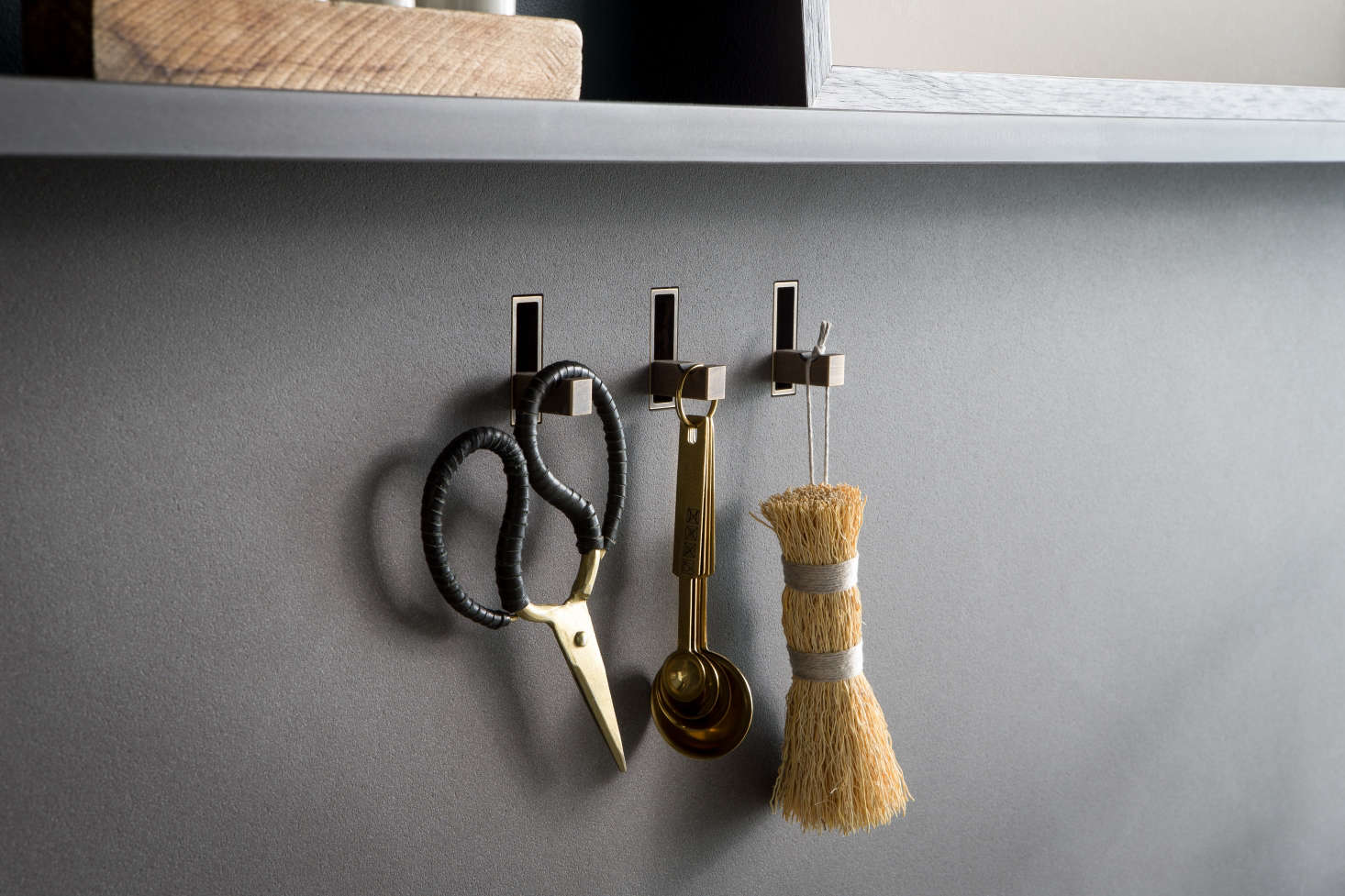 The hooks are integrated into the backsplash and can be finished to match any surface, so that when not in use, they disappear. For sink accessories, browse our Brushes & Sponges finds.