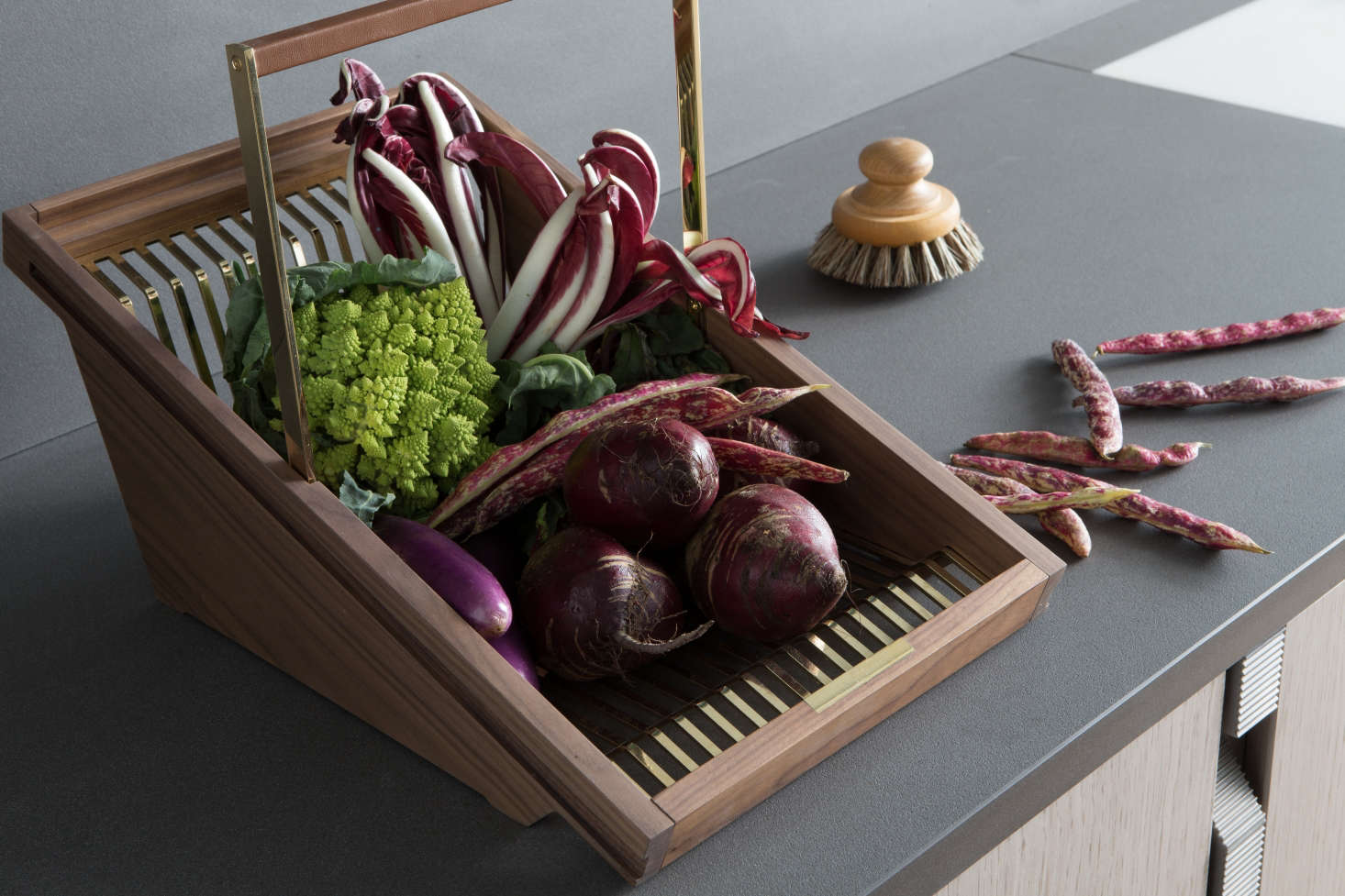 A refined version of the classic garden trug, Lanserring's wood and brass baskets can go from garden to counter to fitted cabinet shelves, where they're used as storage for perishables that don't require refrigeration, such as apples, potatoes, and onions. (The showroom's refrigerator, by the way, is in the pantry.)