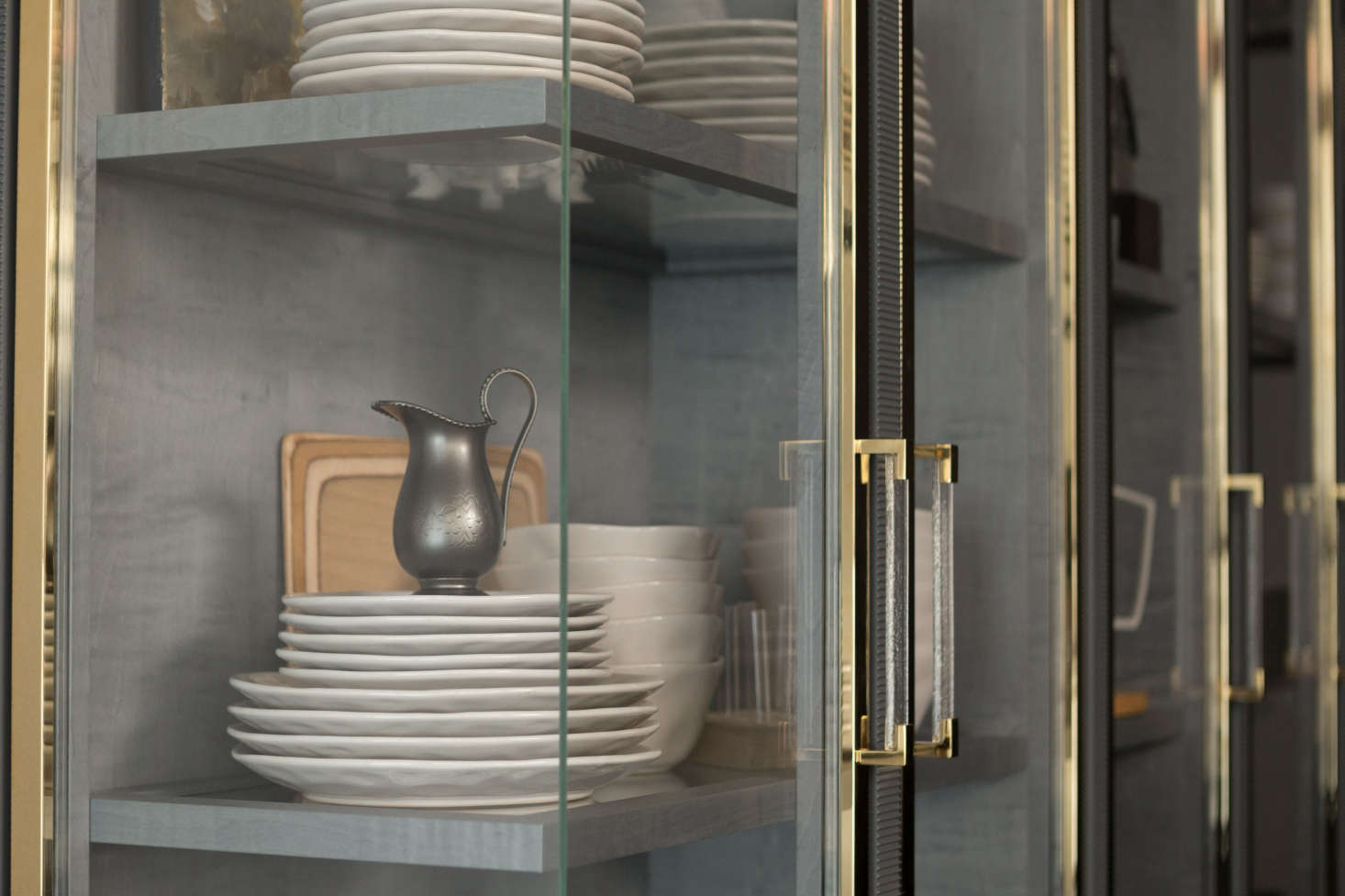 One of the kitchen's references to John Tradescant, the botanist and collector, is its cabinet-of-curiosities-inspired vitrine with glass corners and a gray interior of stained sycamore.