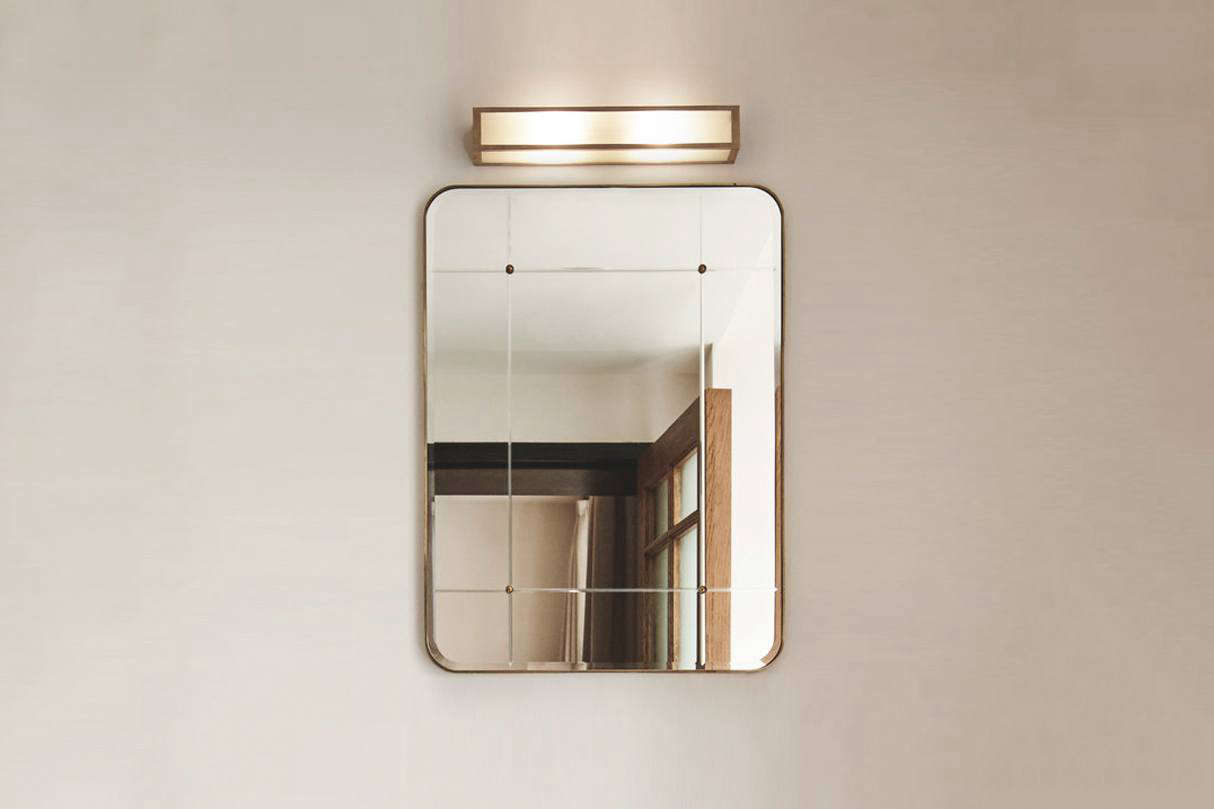 TheLind & Almond A Bathroom Mirror for Sanders is framed in hand-patinated brass. Contact Lind & Almond for ordering information.