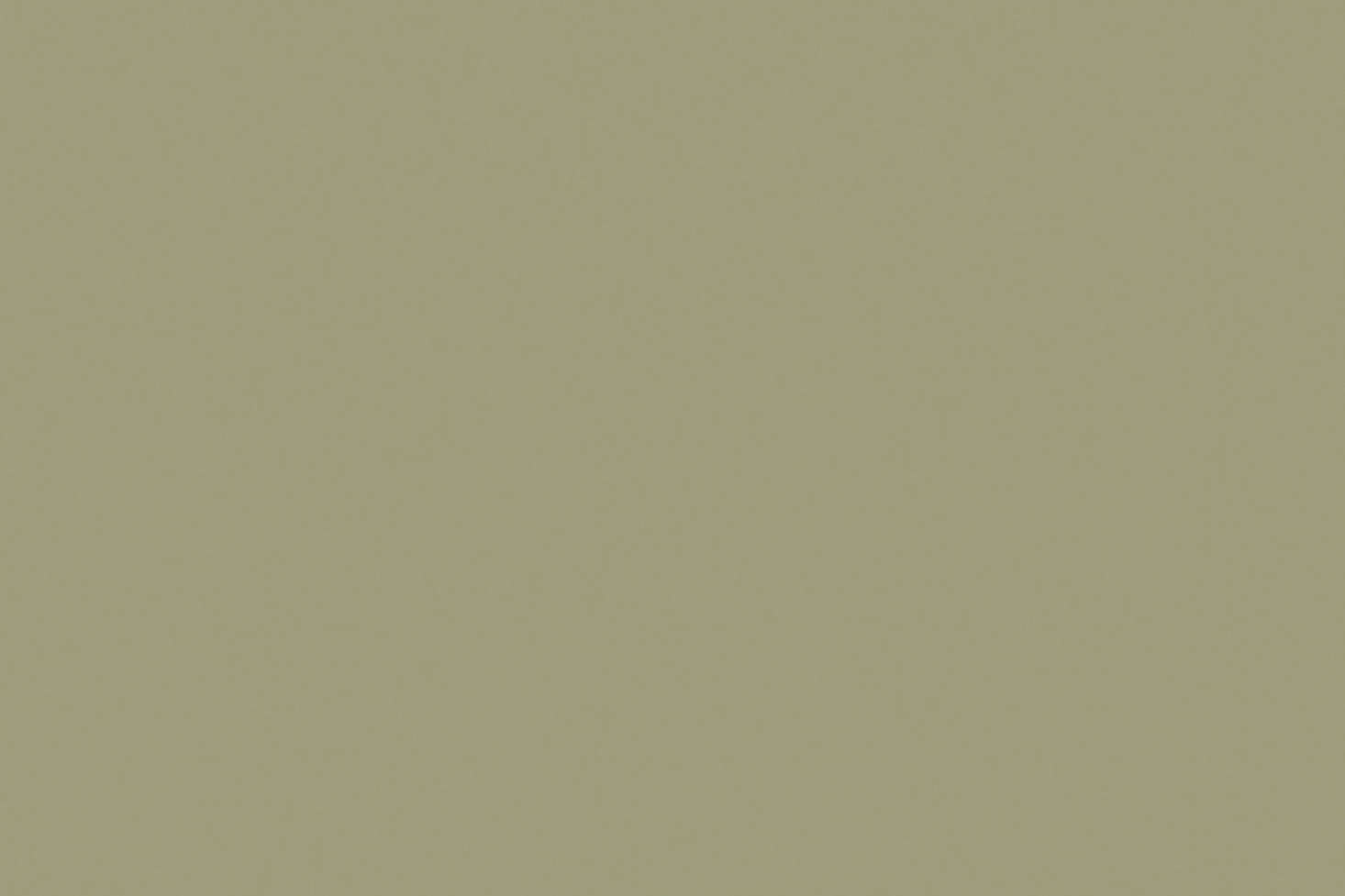 The walls are painted in a custom sage green color that's similar to Little Greene Normandy Grey.