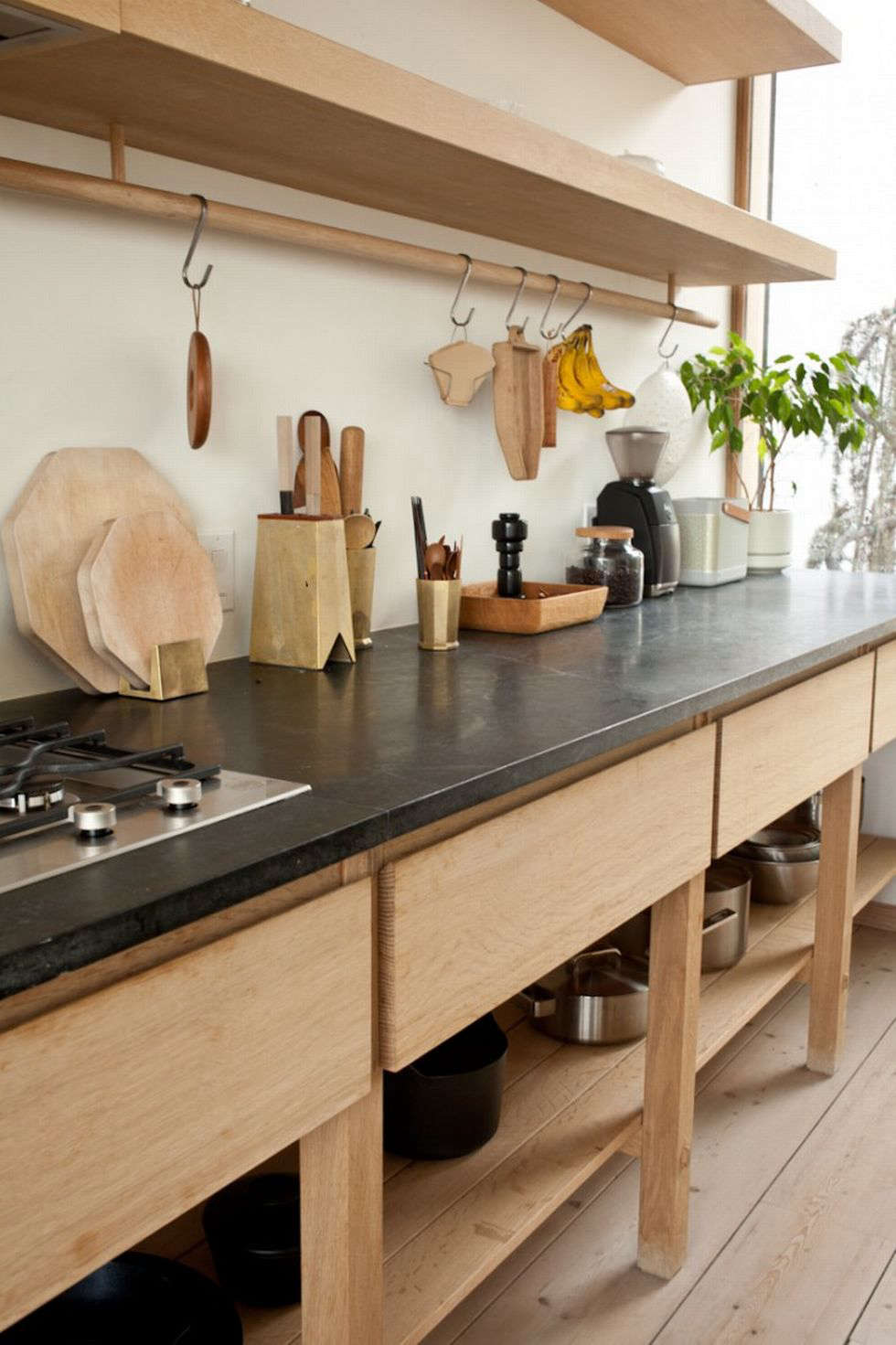 A custom oak cabinet with soapstone counters