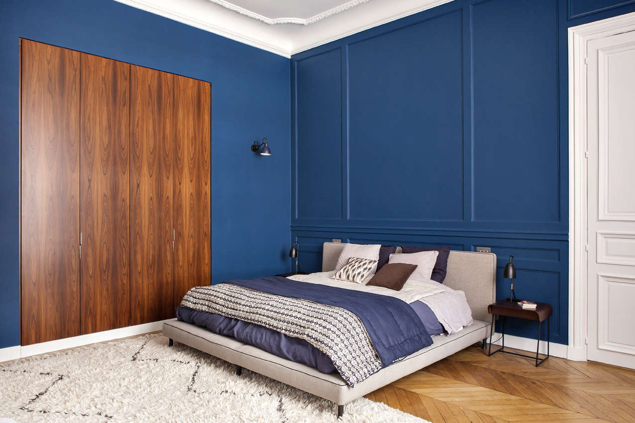 The master bedroom is painted in T0.30. from Dutch paint brand Sikkens, and the bed is Poppi from French brand Caravane. The closet doors are solid rosewood.