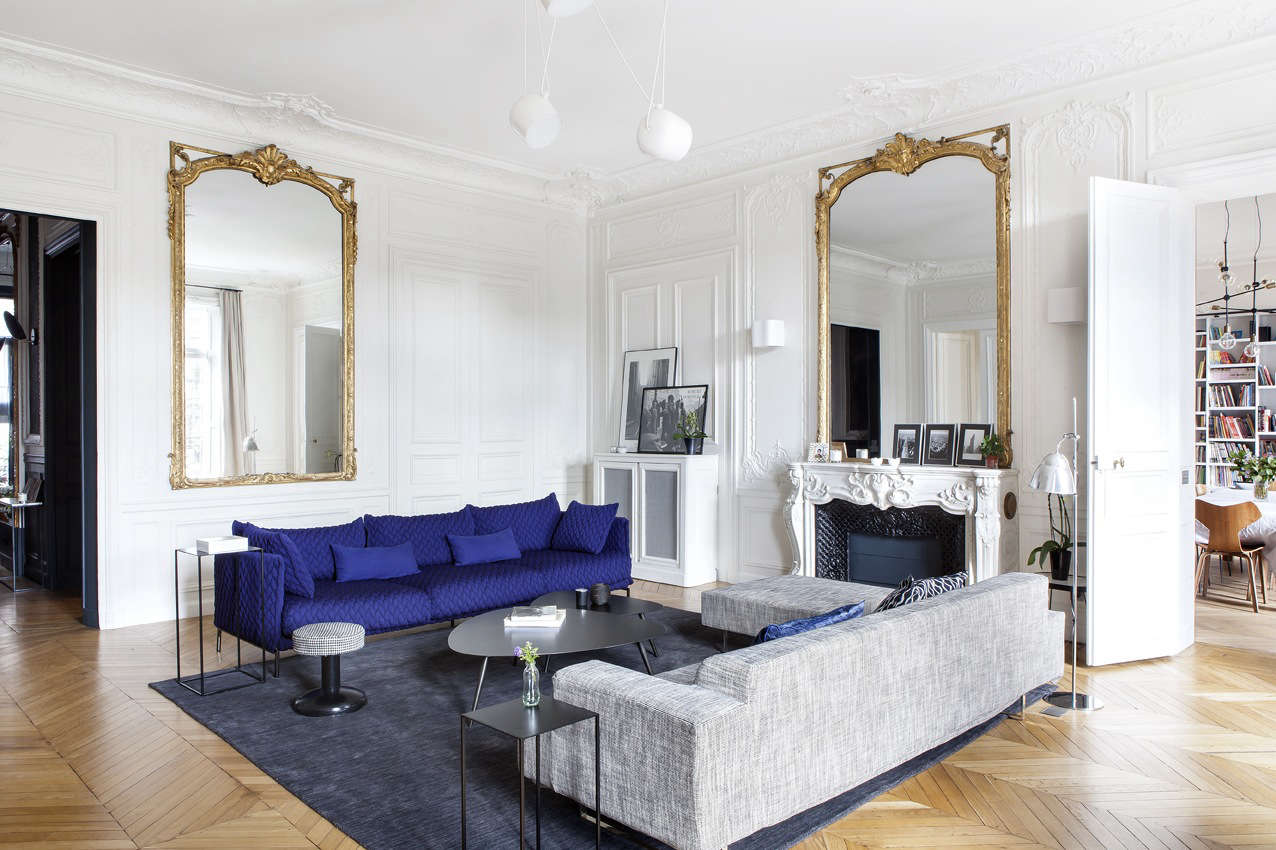 In the formal living room just off the entrance hall sits a Gentry sofa by Patricia Urquiola in bold blue and an Aim Suspension Light by the Bouroullec Brothers for Flos.