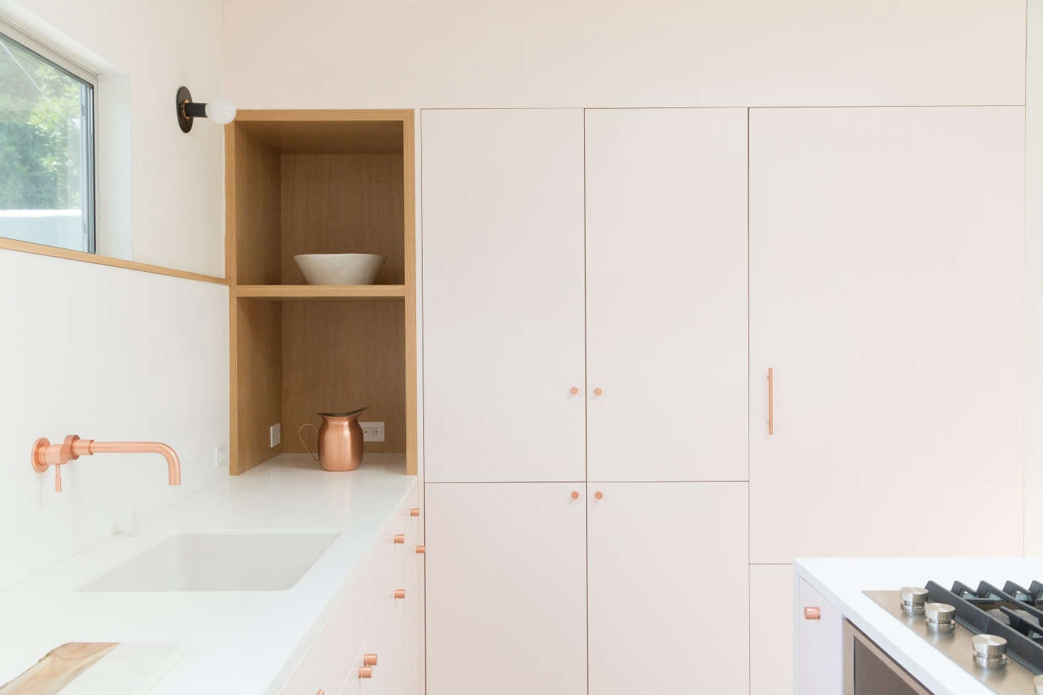 LA architects Annie Ritz and Daniel Rabin renovated their kitchen in Silver Lake to include a wall of cabinets painted pale pink; see more at Kitchen of the Week: Two Young Architects Think Pink in LA. Photography by Lauren Moore, courtesy of Studio Ritz Rabin.
