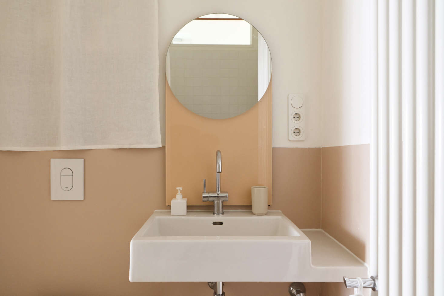 A Geometric Peach Toned Mirror Completes The Palette.