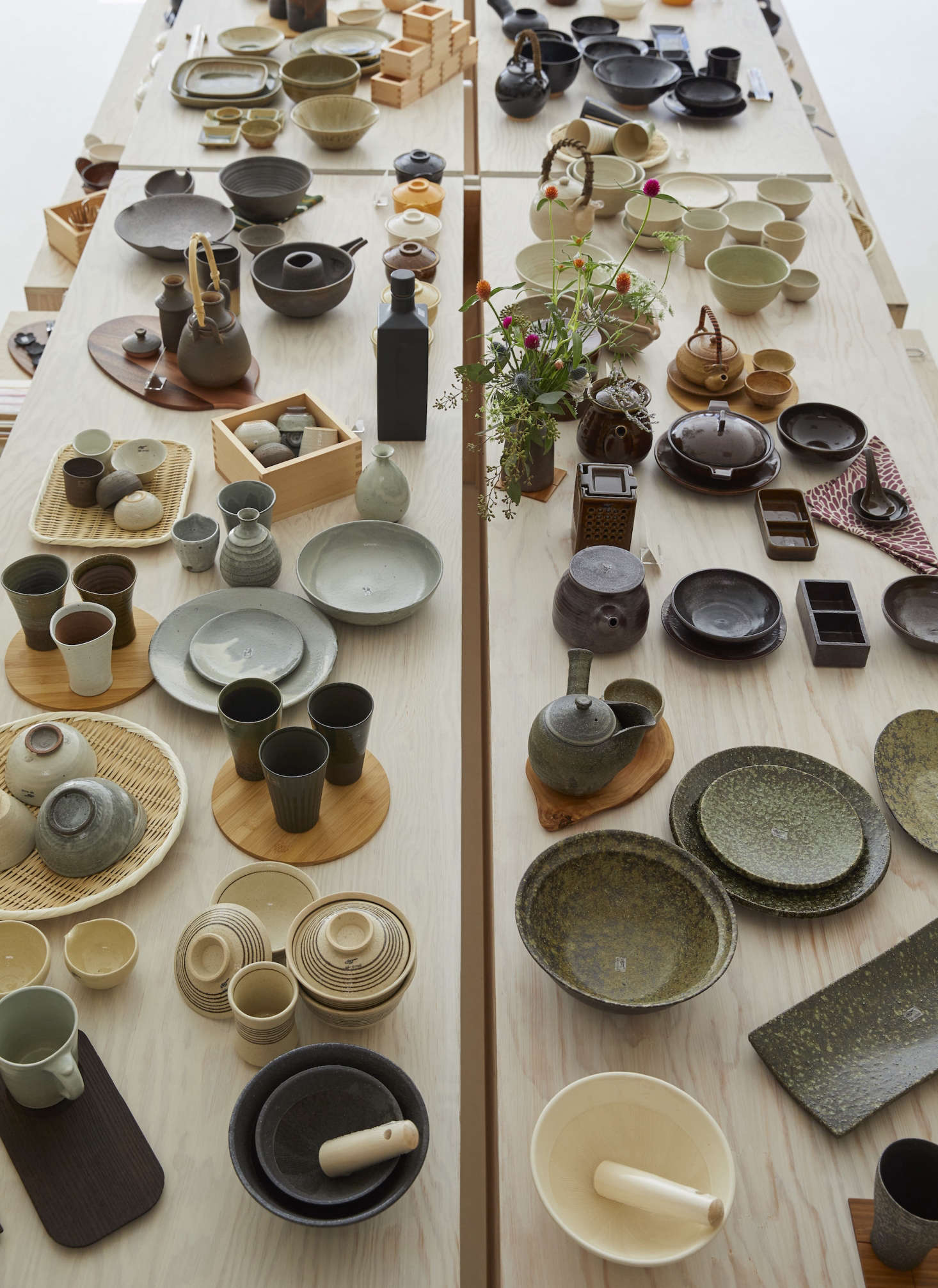 Displayed on tables and benches at the center of the store, the wares include Iga-yaki ceramics—including Sake Flasks, Rice Bowls, and Suribachi Sets (a Japanese mortar and pestle).