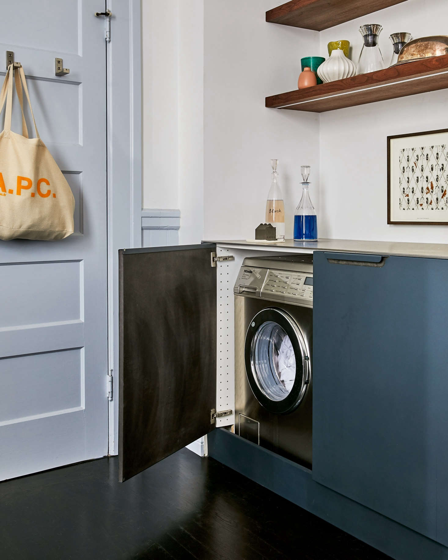 When not in use the washer and dryer disappear behind cabinet doors.
