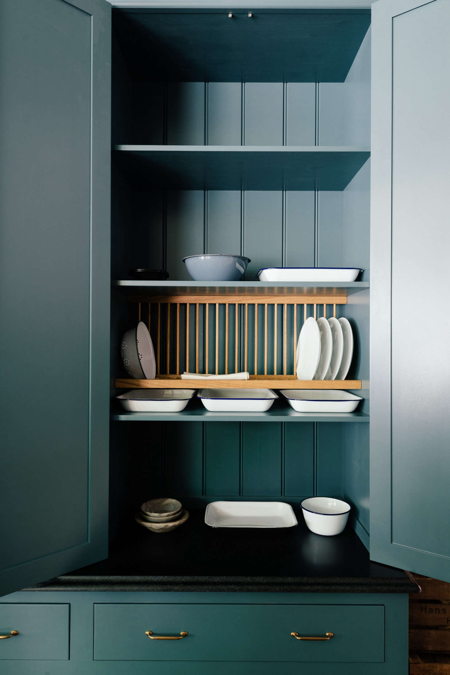 Beadboard can also serve as detailing inside cabinets, as seen with this wide-width beadboard in deVol&#8