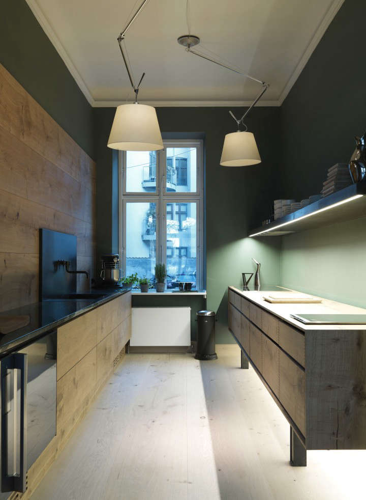 The Dinesen Kitchen series is a collaboration between the venerable Danish flooring makers and kitchen designers Garde Hvalsøe. This one, in Dinesen's Copenhagen showroom, has walls painted in a deep, mossy green. See the rest in Kitchen of the Week: The Dinesen Wood Kitchen. Photograph courtesy of Dinesen.