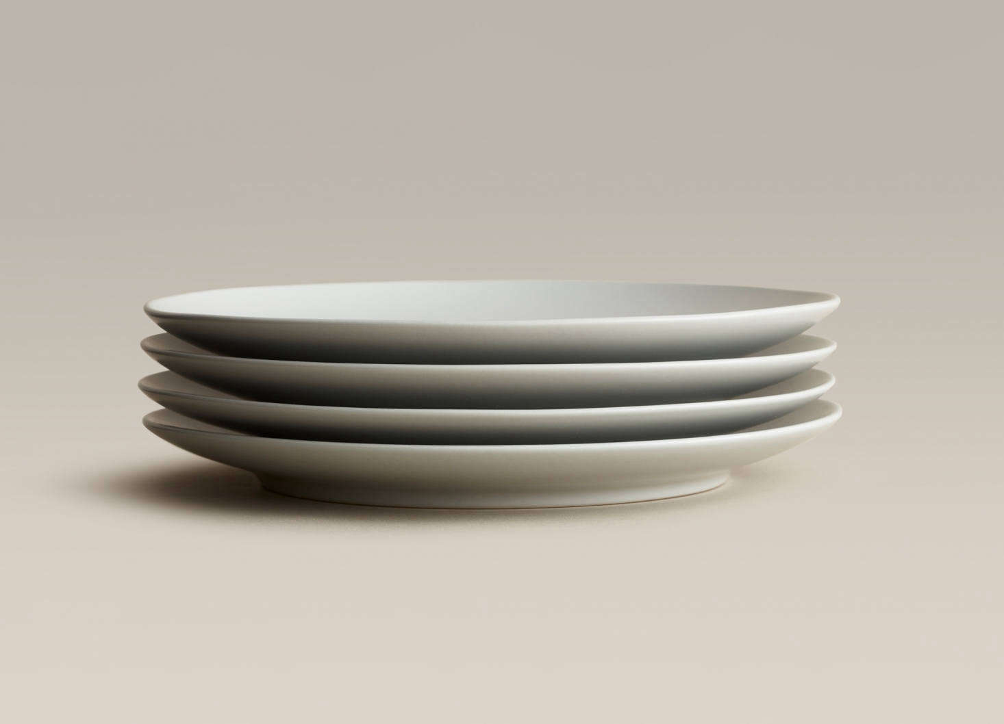 A stack of four Small Plates, suitable for salad and dessert, in Fog; $44 for a set of four.