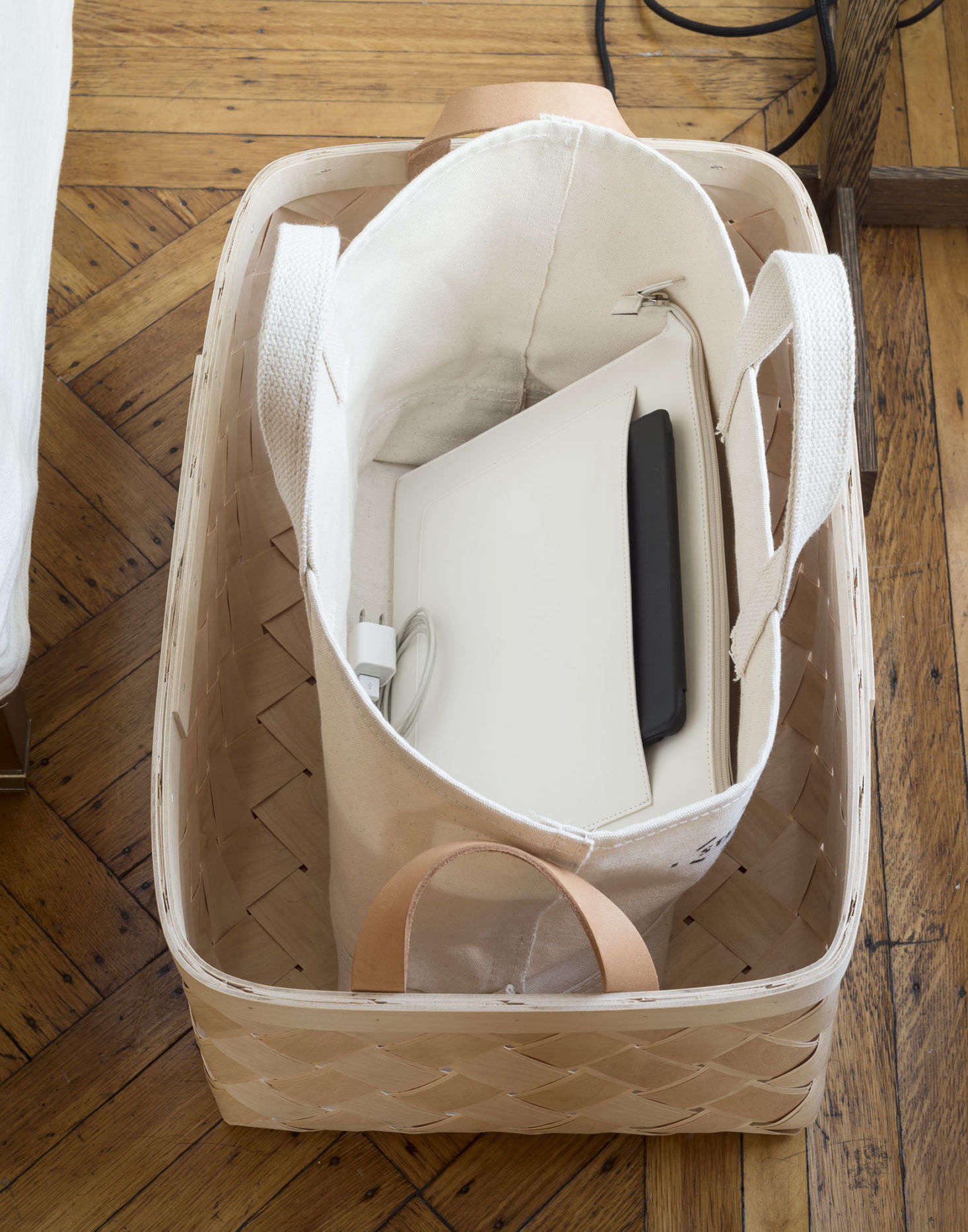 An idea from The Organized Homebook: an office in a bag. Slip your laptop and papers into a bag (we like a stand-up canvas version like this, but any will do); chargers can go into smaller bags inside. Tote it all to your at-home workspace in the morning, then pack it away when it&#8