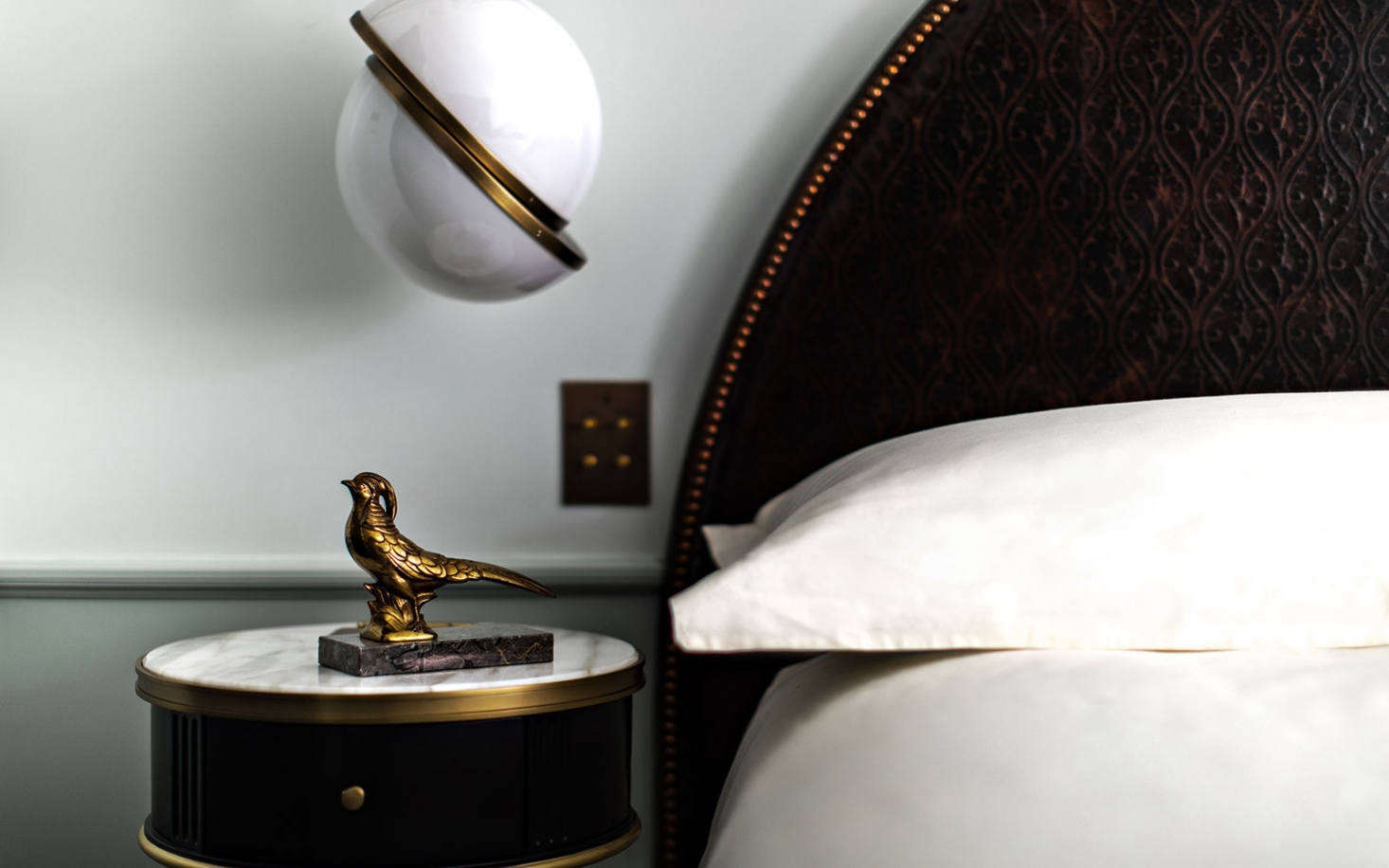 hotel bedroom lighting. Above: A Stately Textured Headboard Is By Muebles Delta; The Spherical Bedside Lighting Hotel Bedroom L