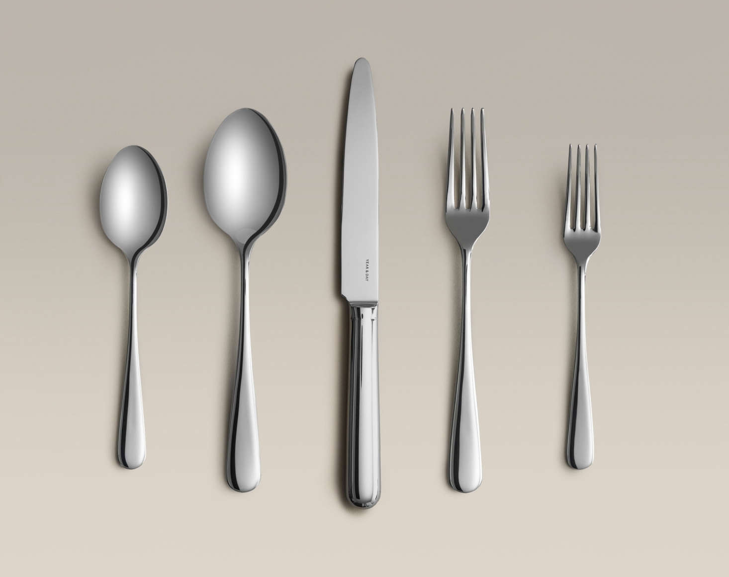 Year & Day offers a set of four five-pieceFlatware Settings in polished stainless steel (shown), matte black, and matte gold. The flatware is made in a family-owned factory in Portugal and finished by hand; $0 for a -piece stainless flatware set. Also on offer: a matching Serving Fork & Spoon ($45 for stainless steel).
