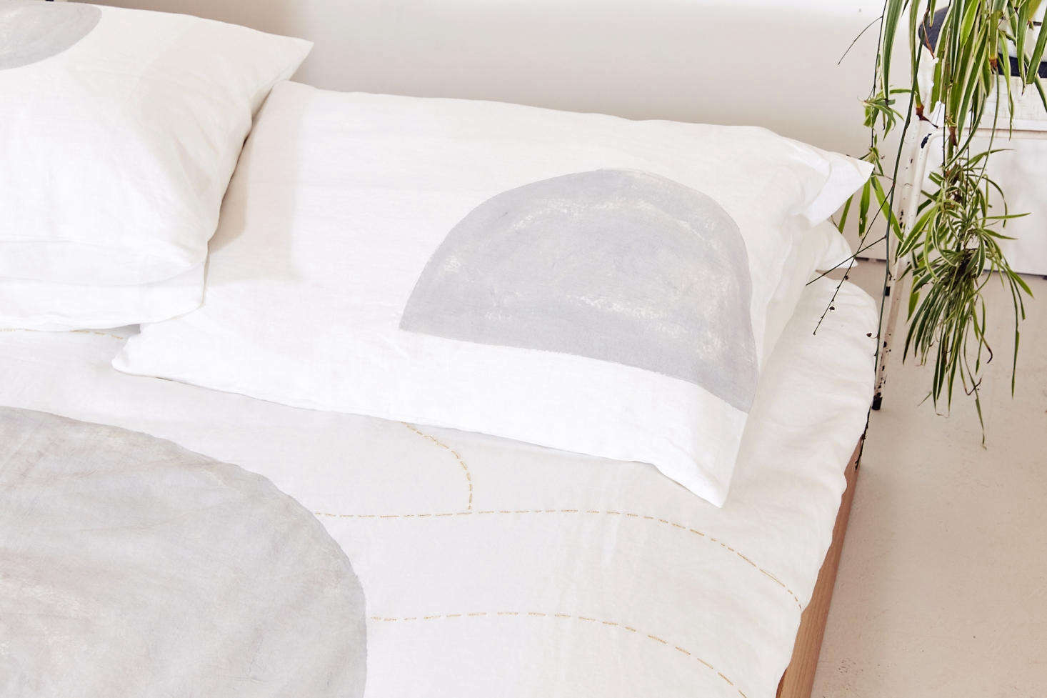 To add dimension, Vallentine finishes some of the duvets with subtle gold embroidery that she hand stitches herself.