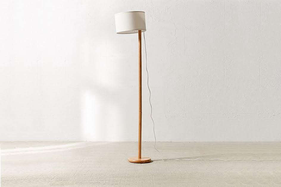 The Akio Adjustable Floor Lamp, $9 at Urban Outfitters, has a wood base and an adjustable fabric lampshade that can be raised or lowered.