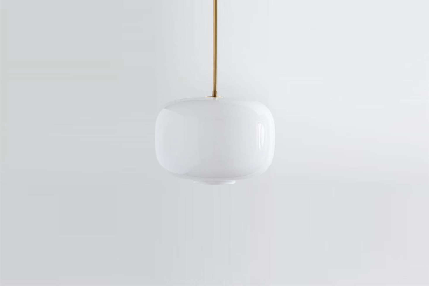The largeSculptural Glass Pebble Pendant with milk glass shade and brass canopy is $129 at West Elm