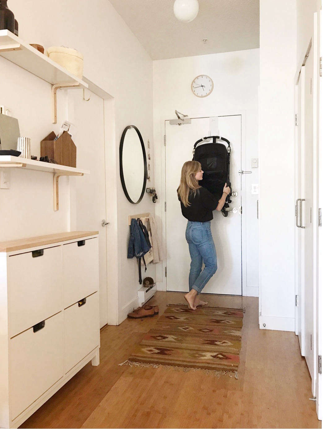 The tidy, spare entryway in small-space blogger Alison Mazurek's Vancouver apartment. See how her family of four manages to live with less in7 Things You Can Live Without in a Small Apartment, from Someone Who's Been There.Photograph courtesy of Alison Mazurek.