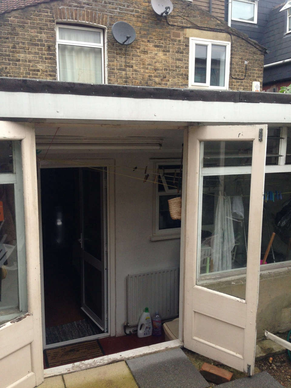 In a prior renovation, a glassed-in narrow porch had been tacked onto the back of the house.