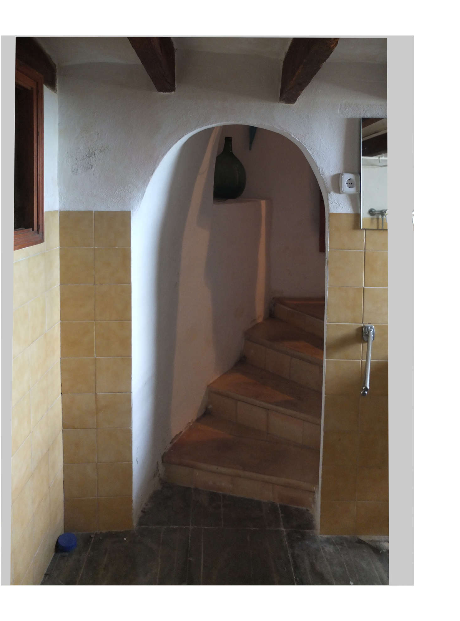The old tiled stairway lead to a dark and cramped bath.