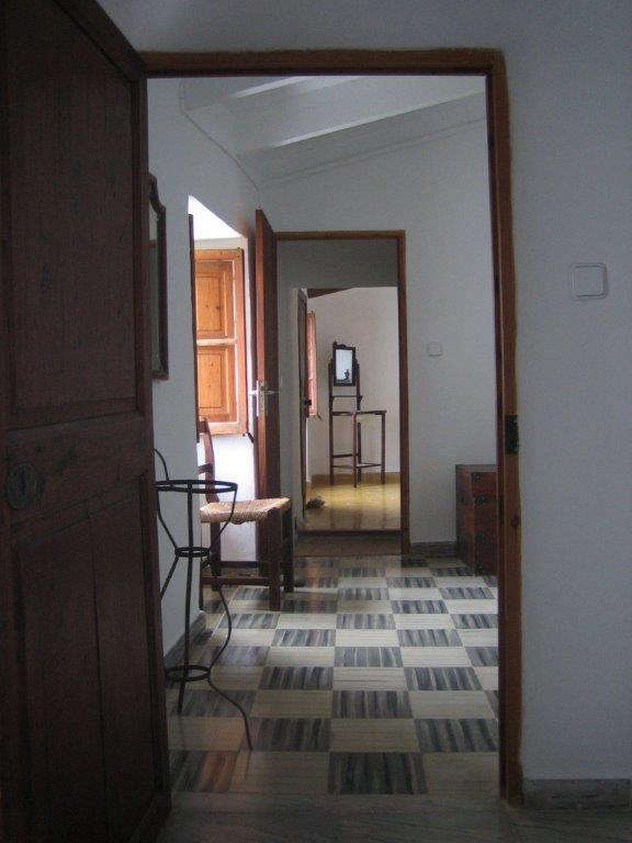 The upstairs, as it was, had dated flooring and dark wood trim.