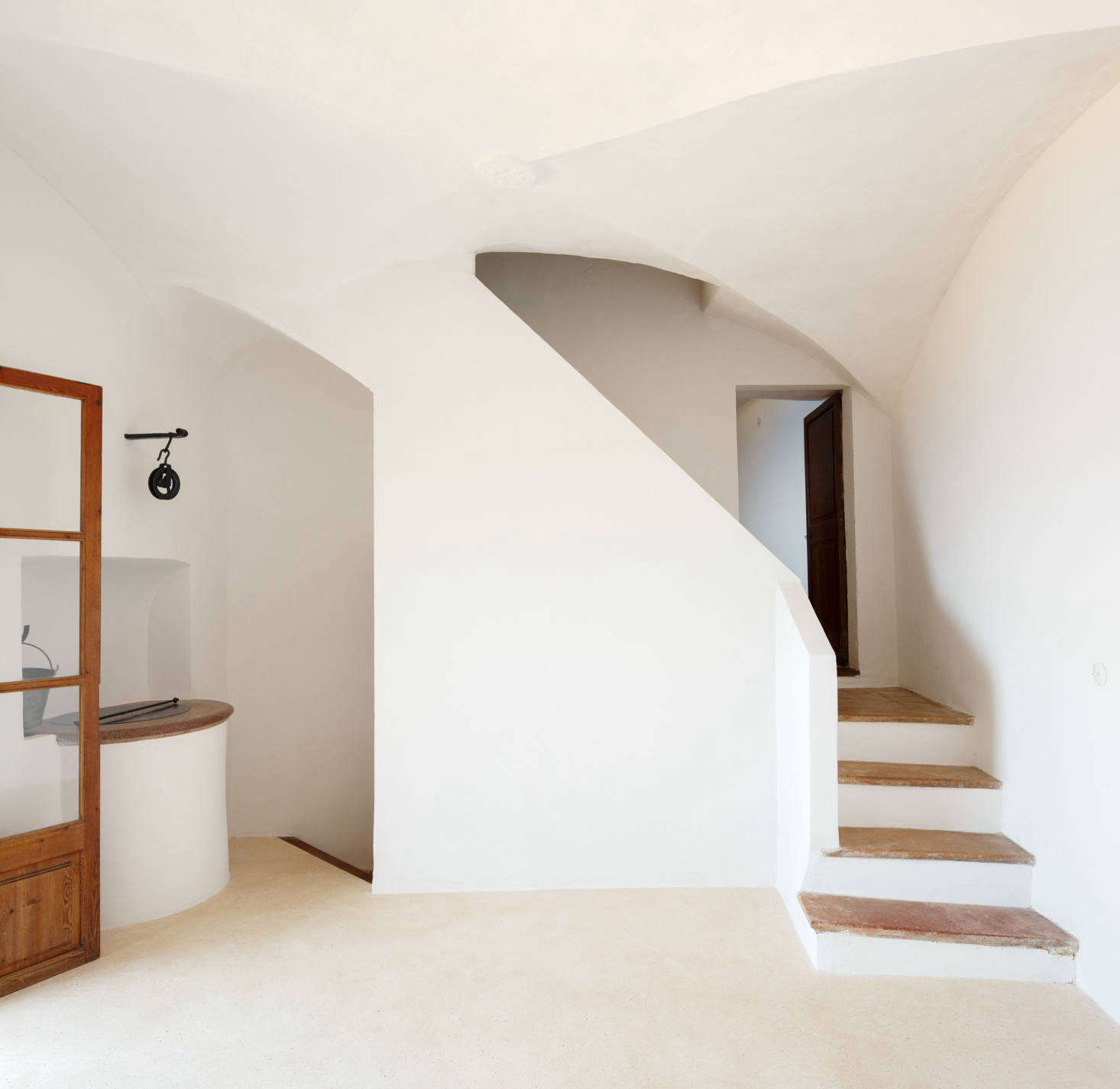 """Two stairways lead to the other rooms: one bathroom, two bedrooms, a """"winter living room,"""" and a small library."""