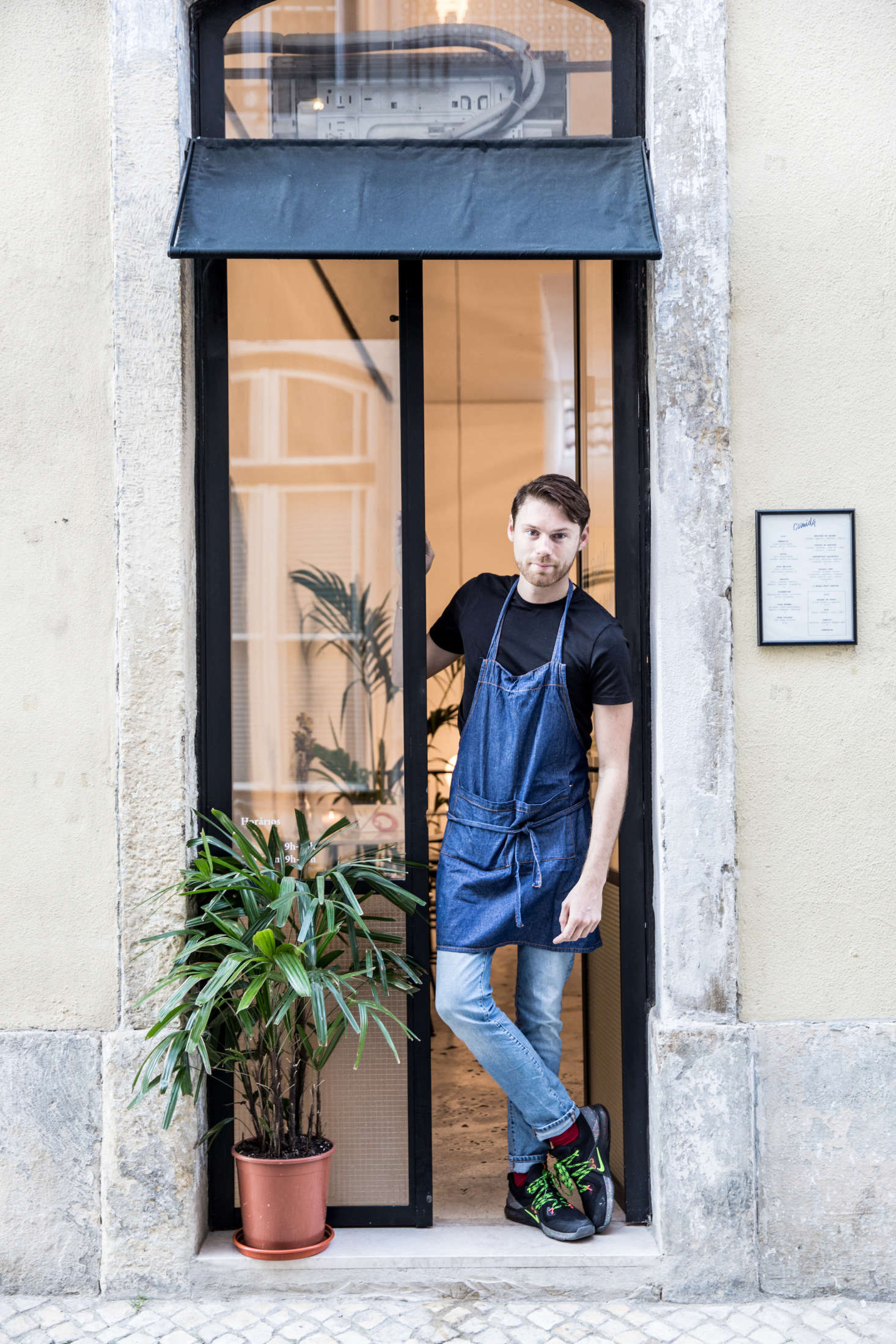 Garrec, who recently moved from New York to Lisbon, in the restaurant's narrow entryway.
