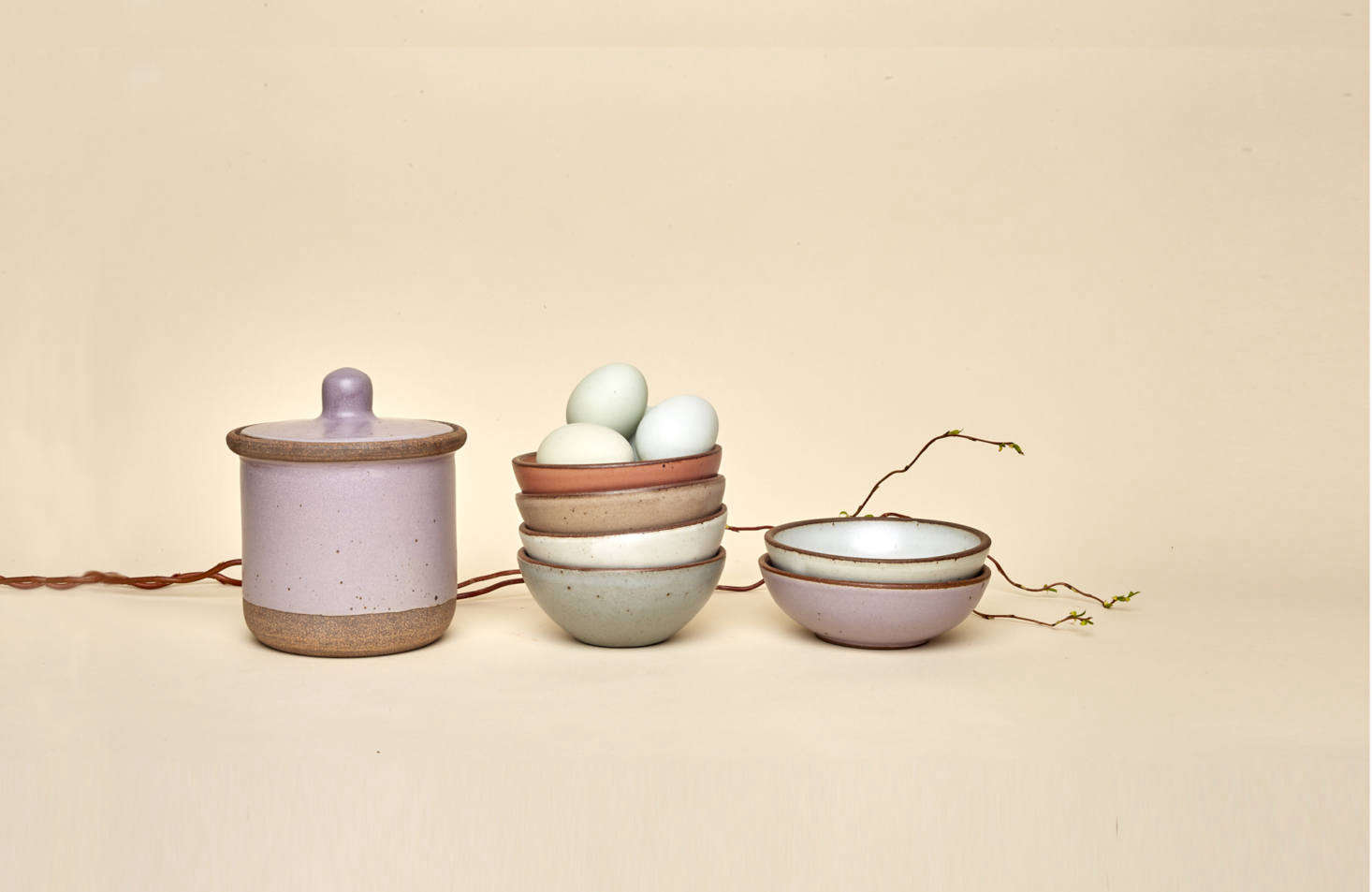 This season's new colorways, Utah (a burnished terracotta) and Taro (a lilac), alongside the existing Eggshell, Soapstone, and Morel glazes. The new glazes are the result of months of testing by the team's resident chemist and made possible by the gas kiln that the company uses. Shown here, left to right: the Medium Jar($78; currently sold out, but back soon), a stack ofSmall Potter's Bowls($28), and two Shallow Breakfast Bowls ($28).