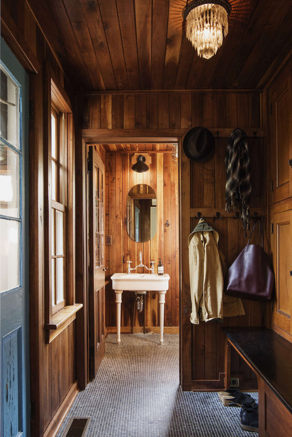 The entryway is lined in the same salvaged oak as the kitchen.