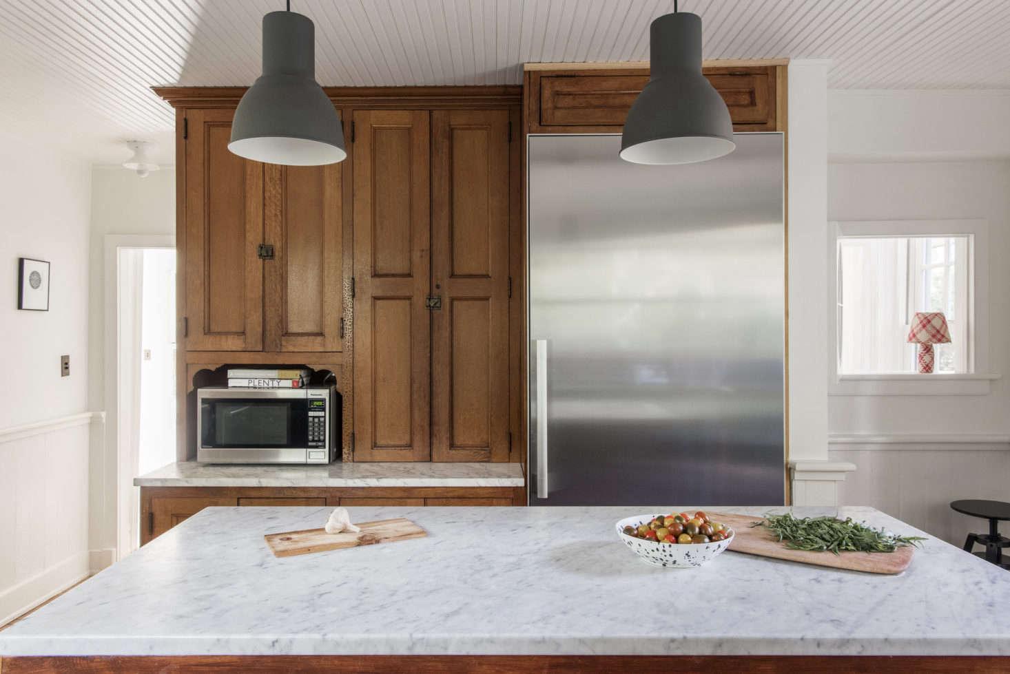 The kitchen pendant lights areHektar from Ikea.