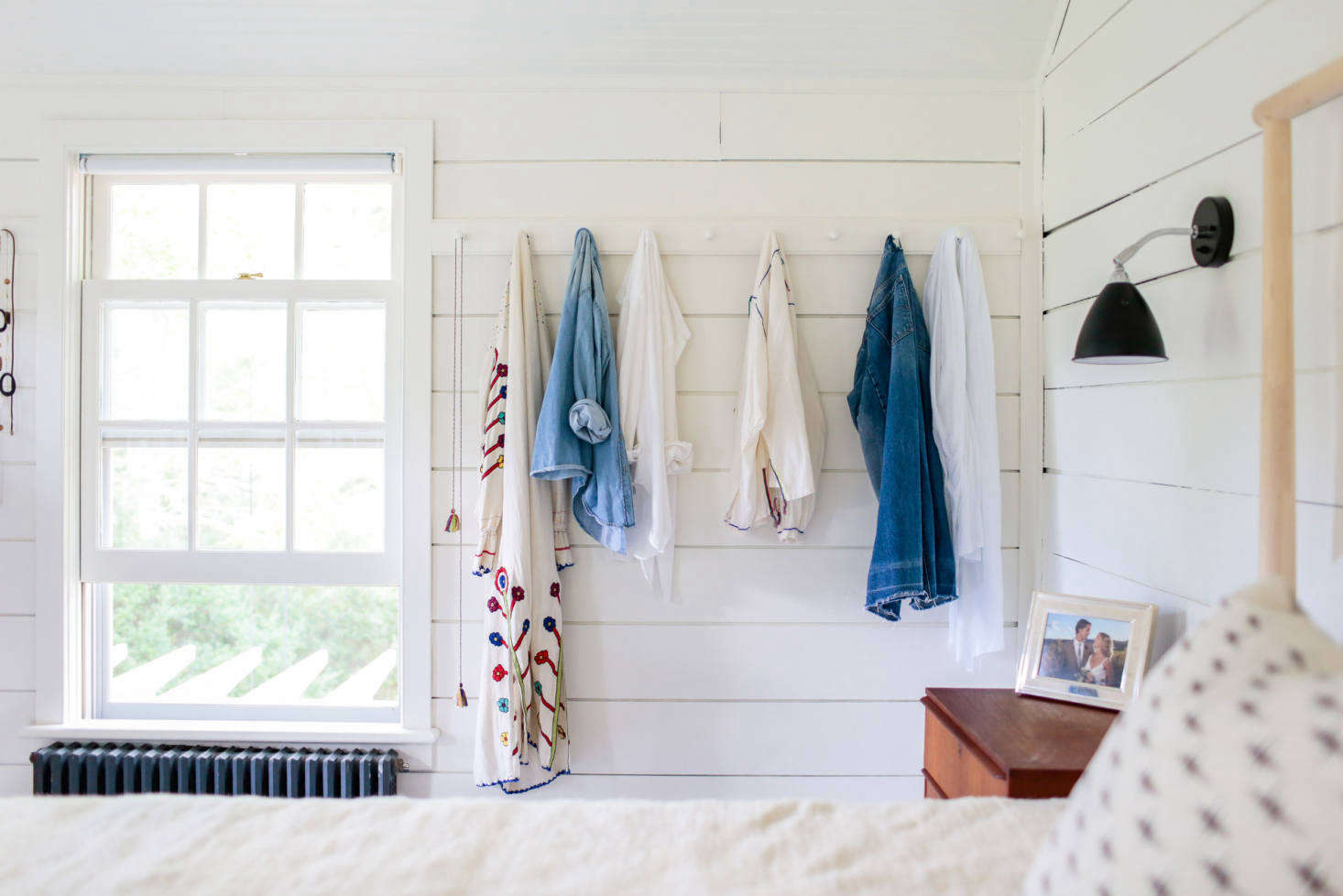 Elizabeth added a row of Shaker peg rails on the far wall of the bedroom (for more, see Christine's post Remodeling 101: How Shaker Peg Rails Saved My Summer Sanity).