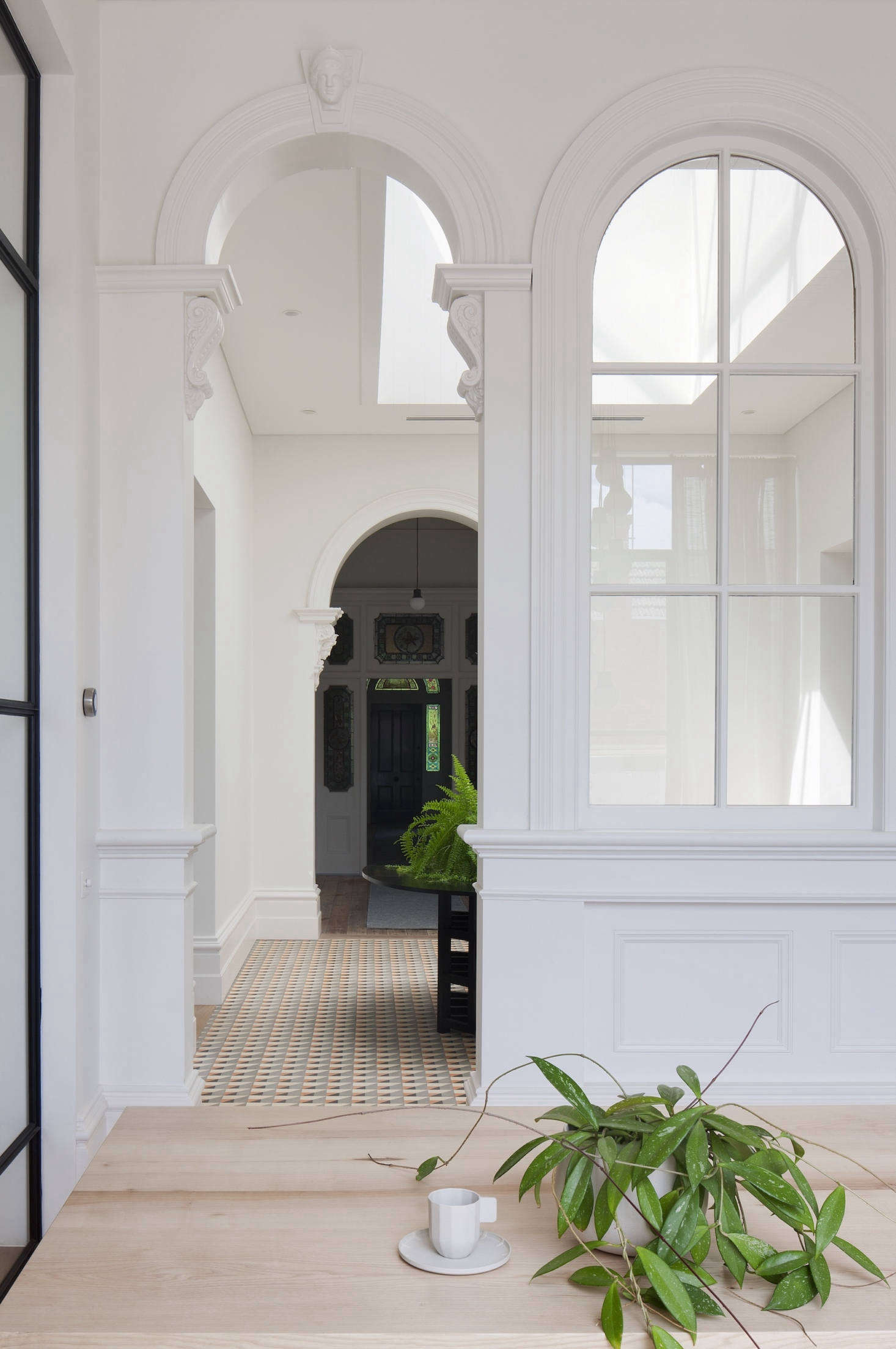 The original decorative archways lead from the foyer to the dining room.