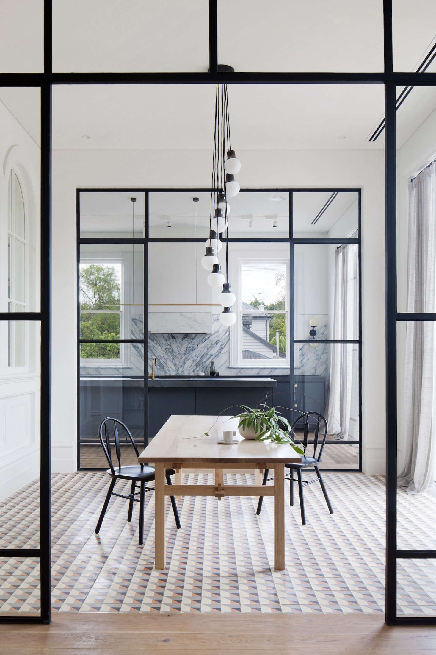 Charming Steel Framed Interior Walls Allow Natural Light To Filter Through The  Rooms. In The Dining