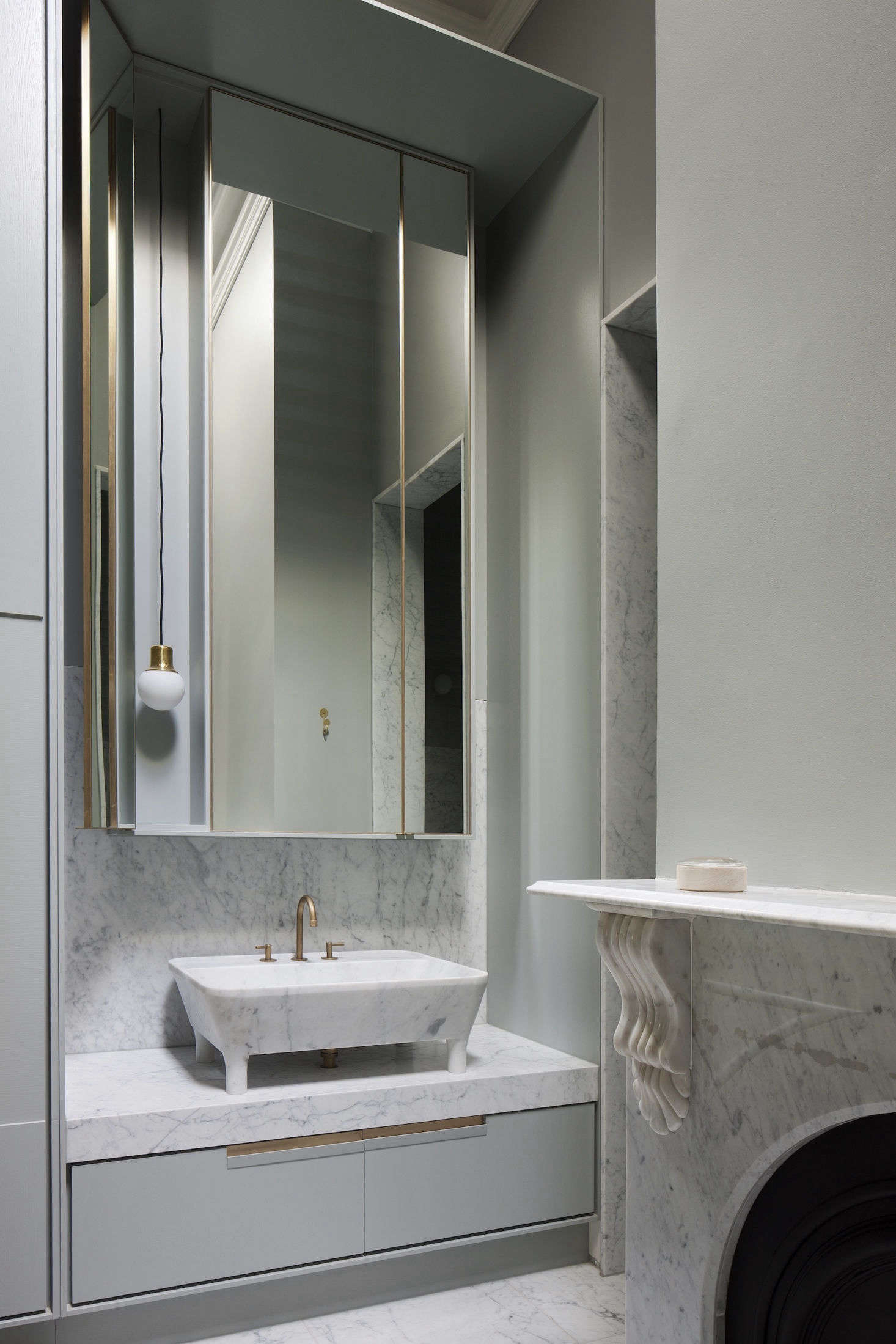 The master bath has a custom marble sink, backsplash, and fireplace surround. The faucet is from Yokato (seeYokato Bath and Kitchen Fixtures, Made in Australia for more).