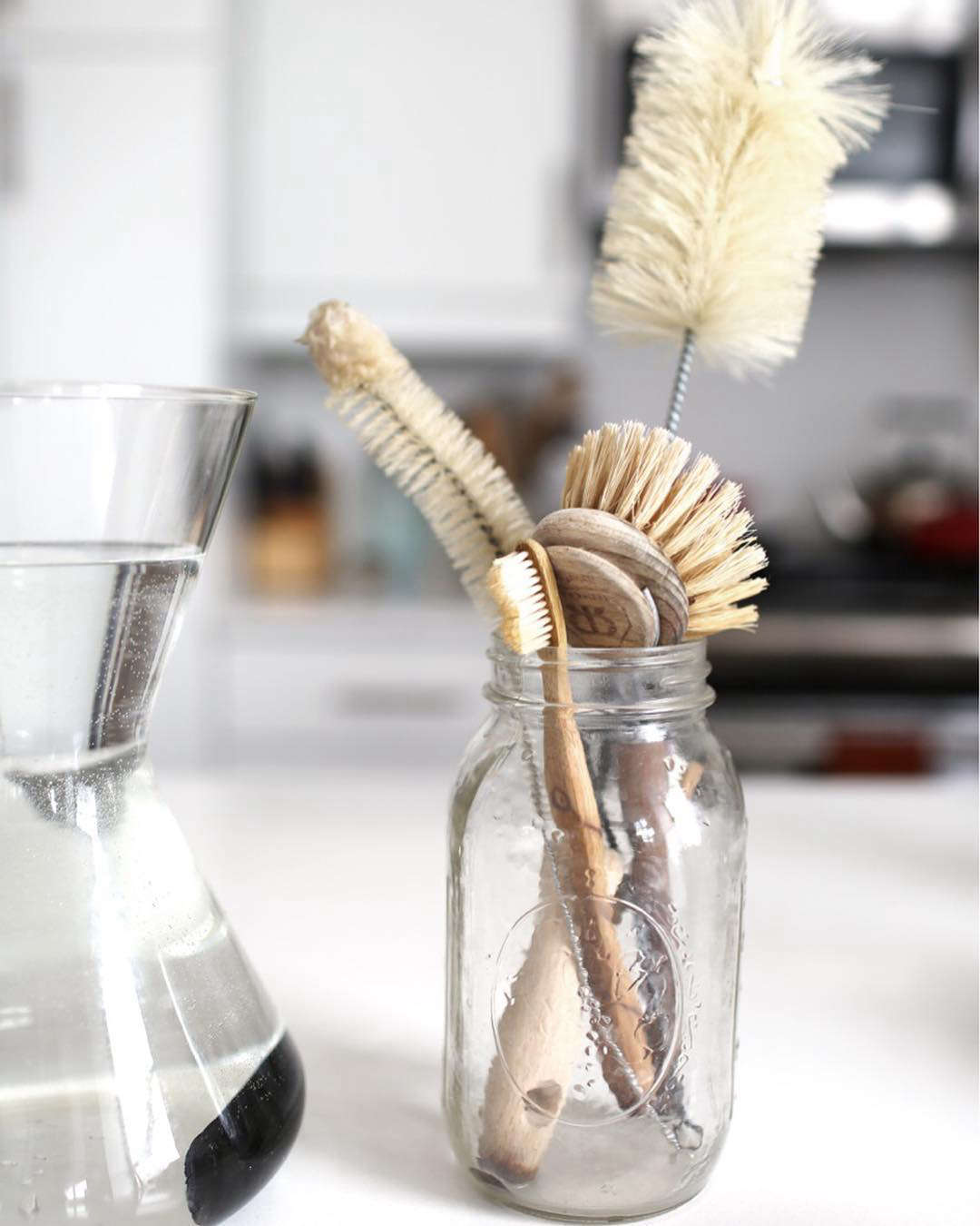 Singer's ensemble of kitchen tools, includes Redecker's biodegradable Dishwashing Brush, $12.50; a Bamboo Toothbrush, $4.99—she uses her old one for scrubbing stains; and Bottle Brushes, $11.85, all from the Package Free Shop.