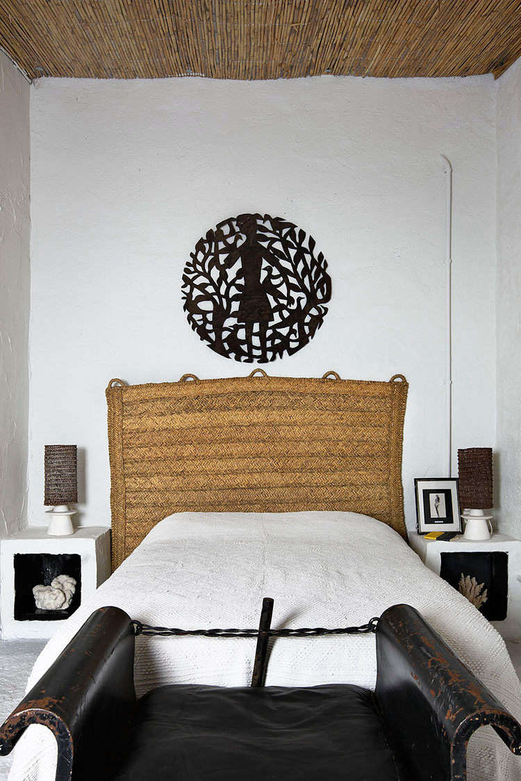 In another bedroom, sculptural built-in nightstands with black-painted niches flank the bed. The rattan headboard is Castella's original design, inspired by straw rugs and handmade by craftsmen in Spain. (See our original post on it, and a few sources for getting a similar look at home, atDesign Idea to Steal: A DIY Headboard from a Natural-Fiber Rug.)
