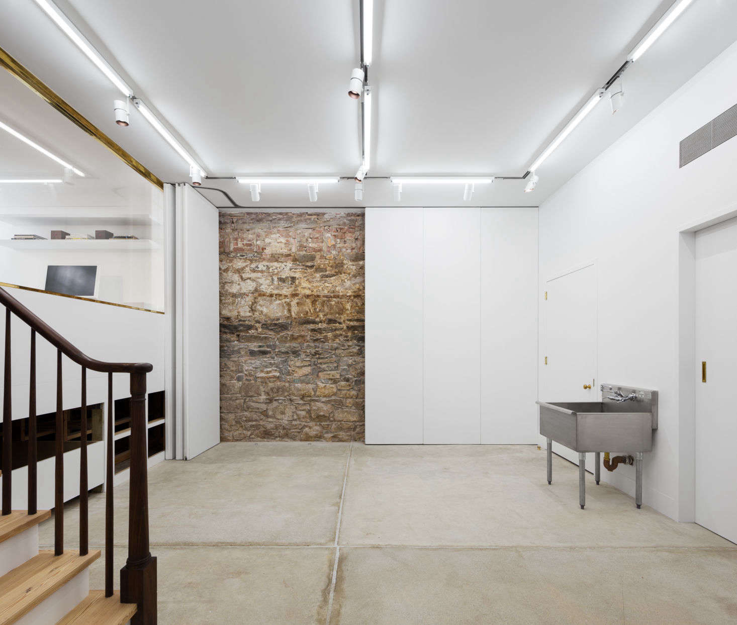 A simple but spotless basement, as seen inLayers of History—and Color—in an Artist Couple's 1828 Manhattan Townhouse.Photography byDevon Banks, courtesy of Yun Architecture.