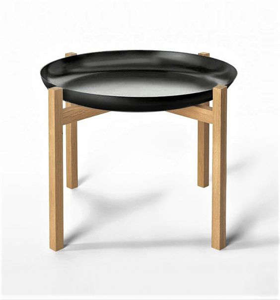 Designed by Magnus Lofgren, Design House Stockholm's Tablo Tray Table is made with a lacquered steel tray in white or black and a teak frame; $335 for the low -inch size and $394.50 for the high -inch size at Horne (contact the shop directly; all models available are not listed on the website).