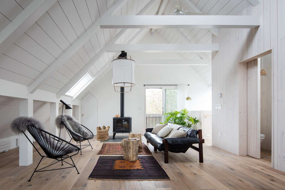 The living area occupies the other side of the airy, open loftlike space.