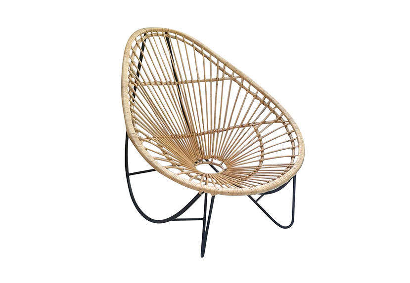 The elliptic Arc Rattan Rocker is inspired by 50s styles; it can function as a rocking chair if you lean back; $400 at LeMay Shop.