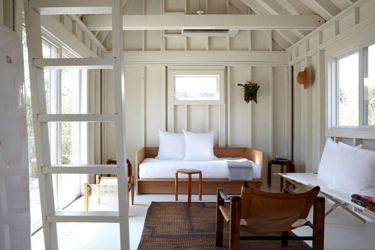 Plywood floors, painted white, in A Chic Fixer-Upper on Fire Island, Budget Edition. Photograph by Kate Sears.