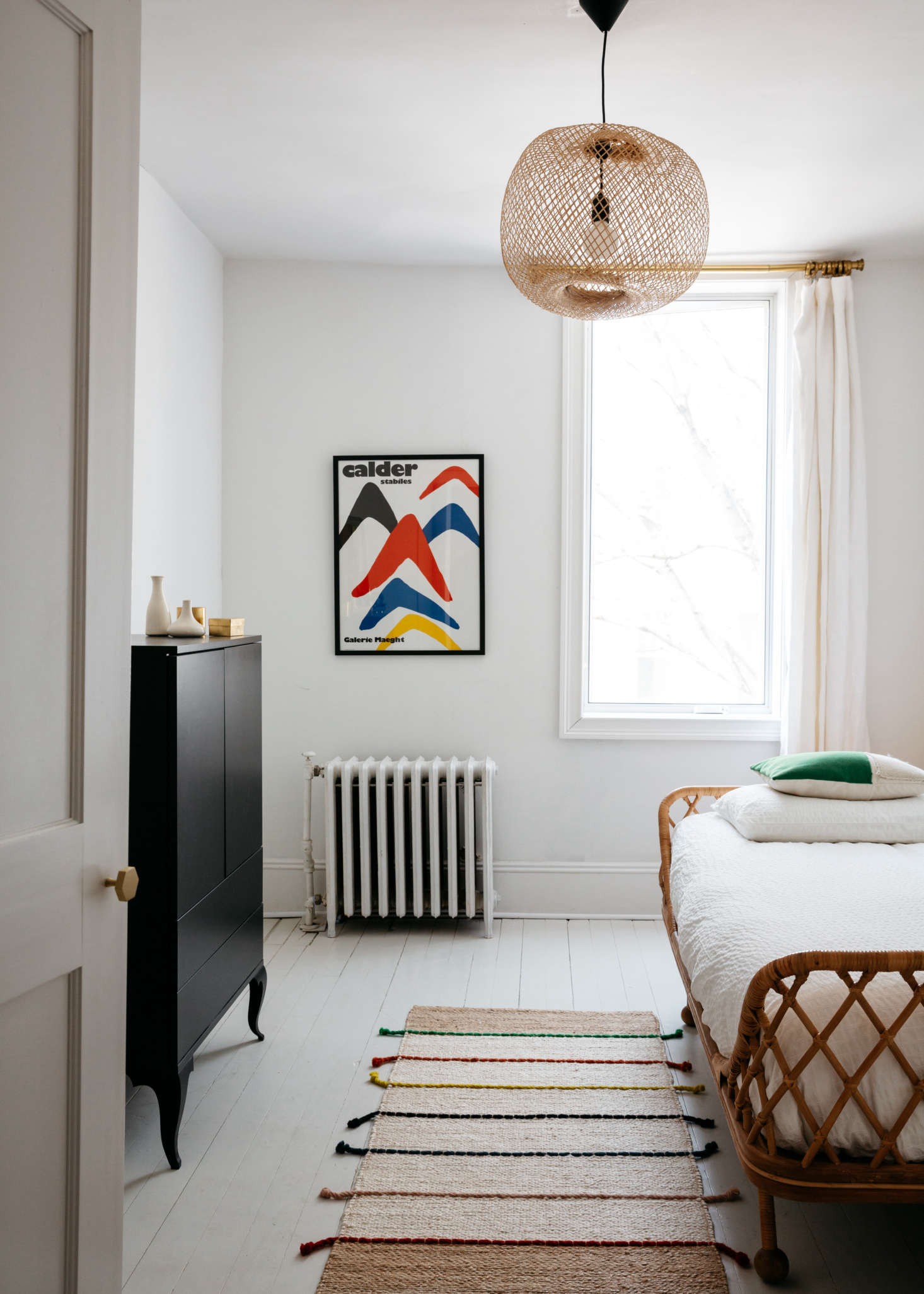 Rattan daybeds aren't just for summer spaces: Anthropologie's Pari Daybed (scroll to the top to see the frame on its own) here furnishes the guest room in A French-Inflected Townhouse in Williamsburg. Photograph by Brian Ferry for Remodelista; styling by Alexa Hotz. (Intrigued? Also see Steal This Look: A Petite-Priced Bedroom.)