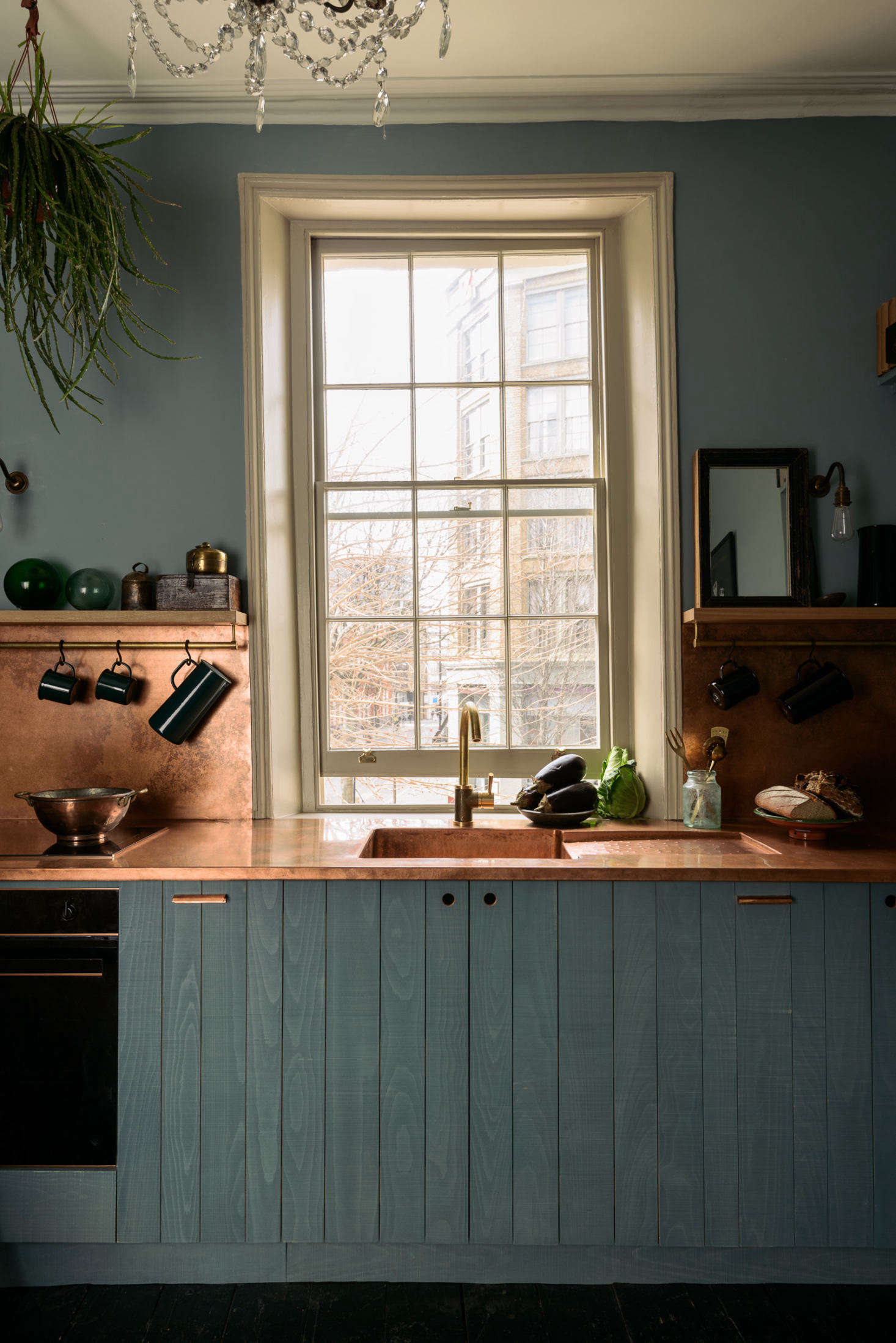 The kitchen has countertopsmade of a single sheet of copper (so no surface seams), with an integrated copper sink. The copper has a matte finish and a lightly pre-applied finish for patina.