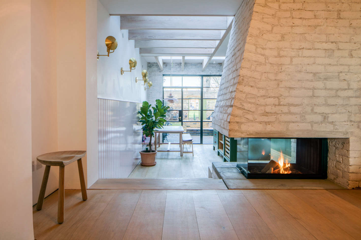 """The centerpiece of the kitchen: a new, custom brick fireplace. """"We also have an unhealthy obsession with wood-burning fireplaces,"""" Toke says."""