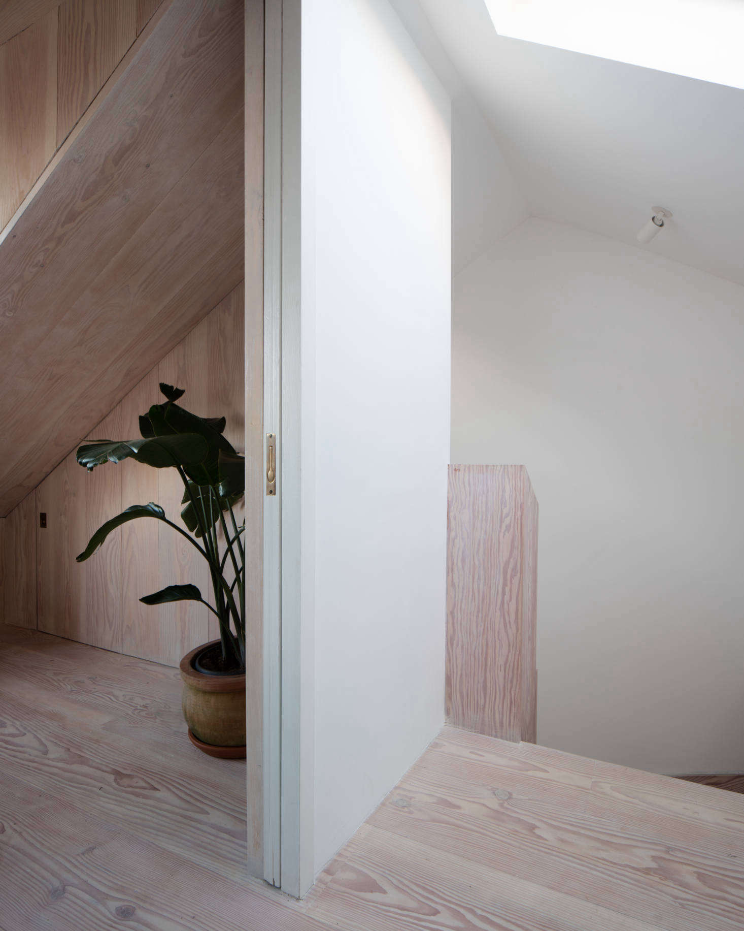 Upstairs, more Dinesen, including the stair surround.